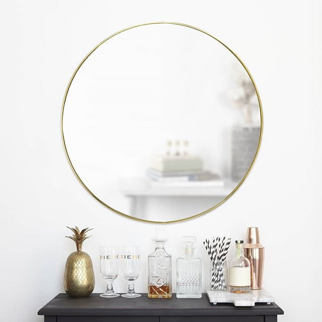 """Did someone say Hubba (Hubba)? Freshen up the look of your room with this brand new mirror collection from Umbra. Available with a brass or titanium rim, this Hubba Mirror is not only complimentary to any interior but helps brighten even the darkest of spaces. Dimensions: 34""""  #Umbra #UmbraDesign Design: @sungwook_84"""