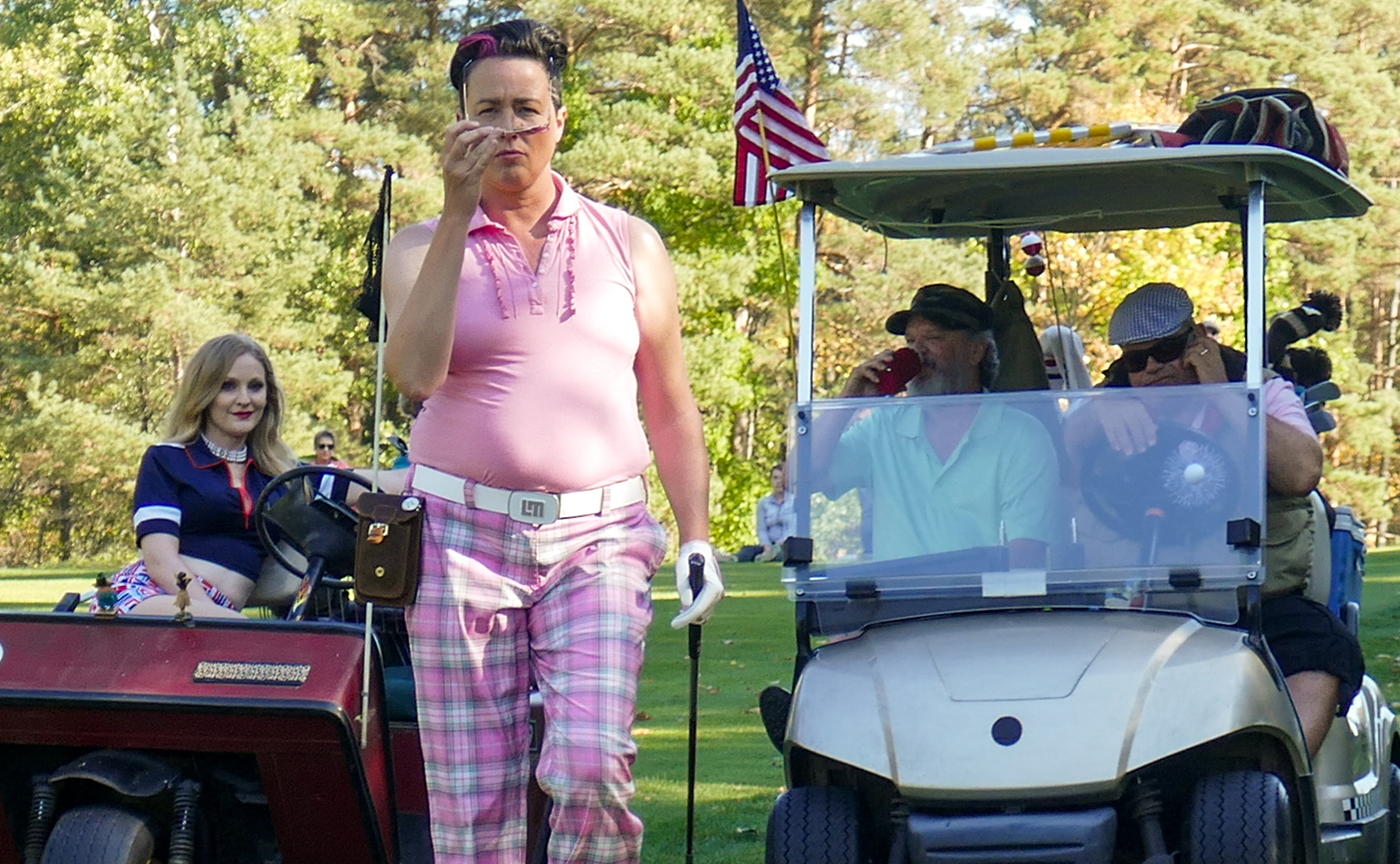 Angela playing golf champion Tracy in  Eagle and the Albatross.