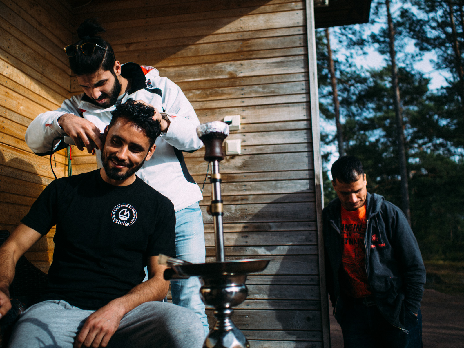 Ihab and Yousuf invited over a friend who they met during the months spent at the refugees centre. He's a hairdresser from Baghdad and arrived in Finland together with his wife and kid.