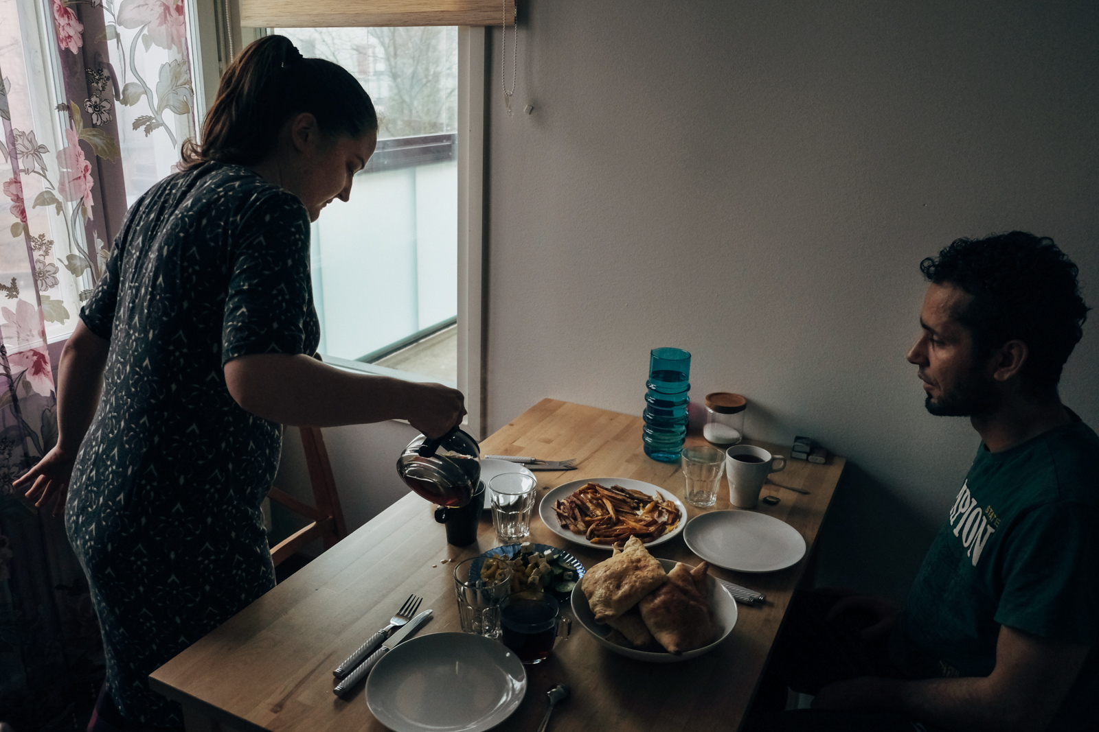 Ihab and Minttu at home during a morning breakfast. They met when Ihab was still living in Velkua and after he got his asylum request accepted they decided to move together.
