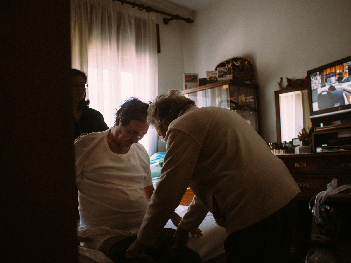Since the loss of his father, there was a necessity to have someone help him in his everyday activities, going to bed, waking up, showering, going to toilet, so they hired a caregiver who's there for Flavio day and night.