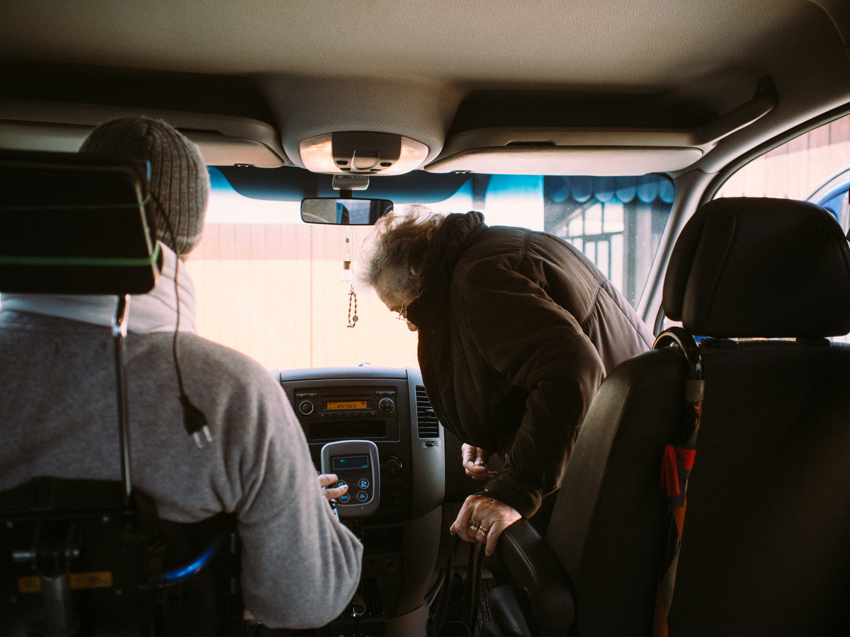Because of the early stage of the disease, Flavio still manages to drive his truck, specially modified for him. So almost every day he takes his elderly mother to the city center to run errands.