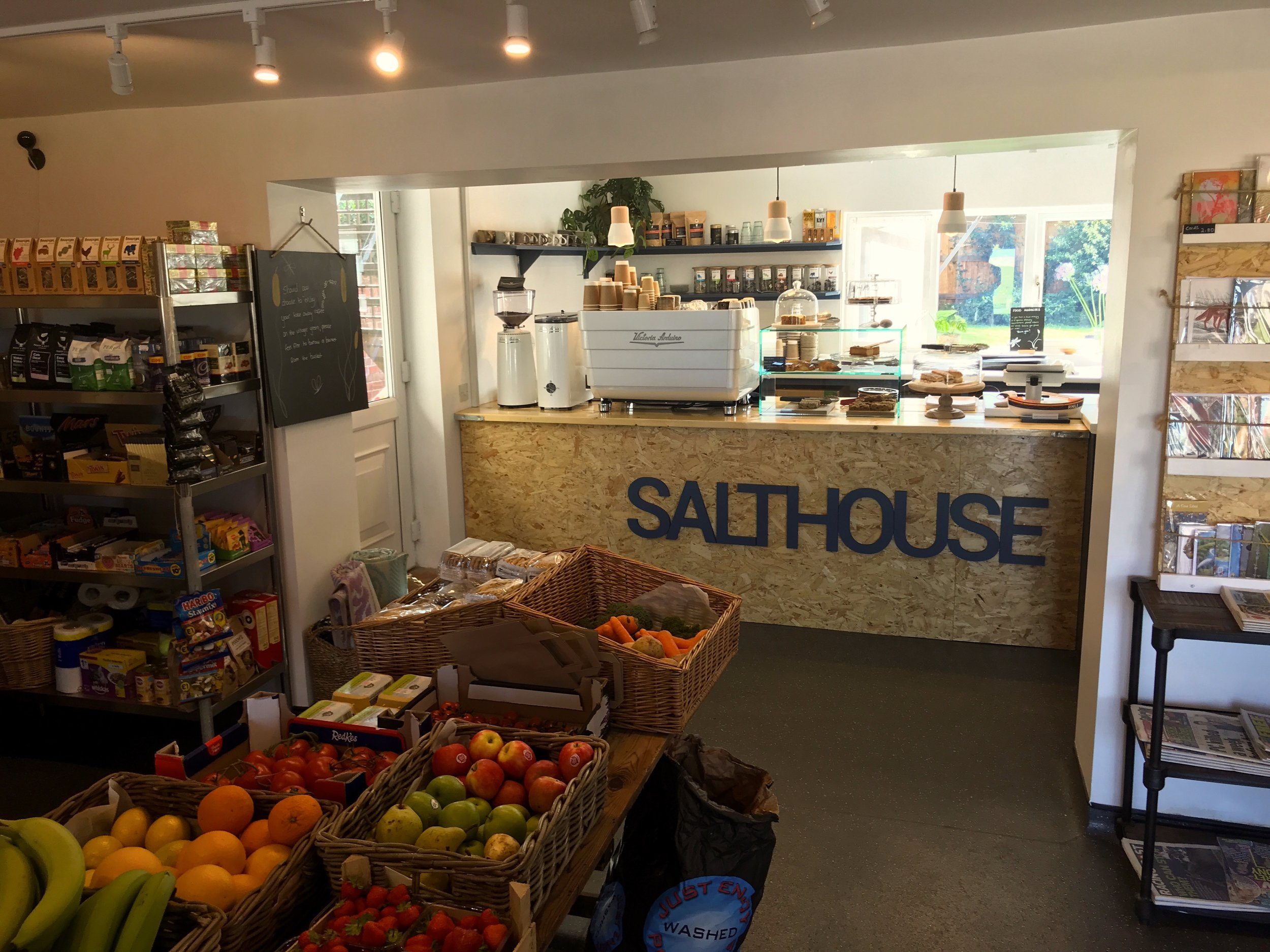 Fresh fruit and vegetables and store counter.