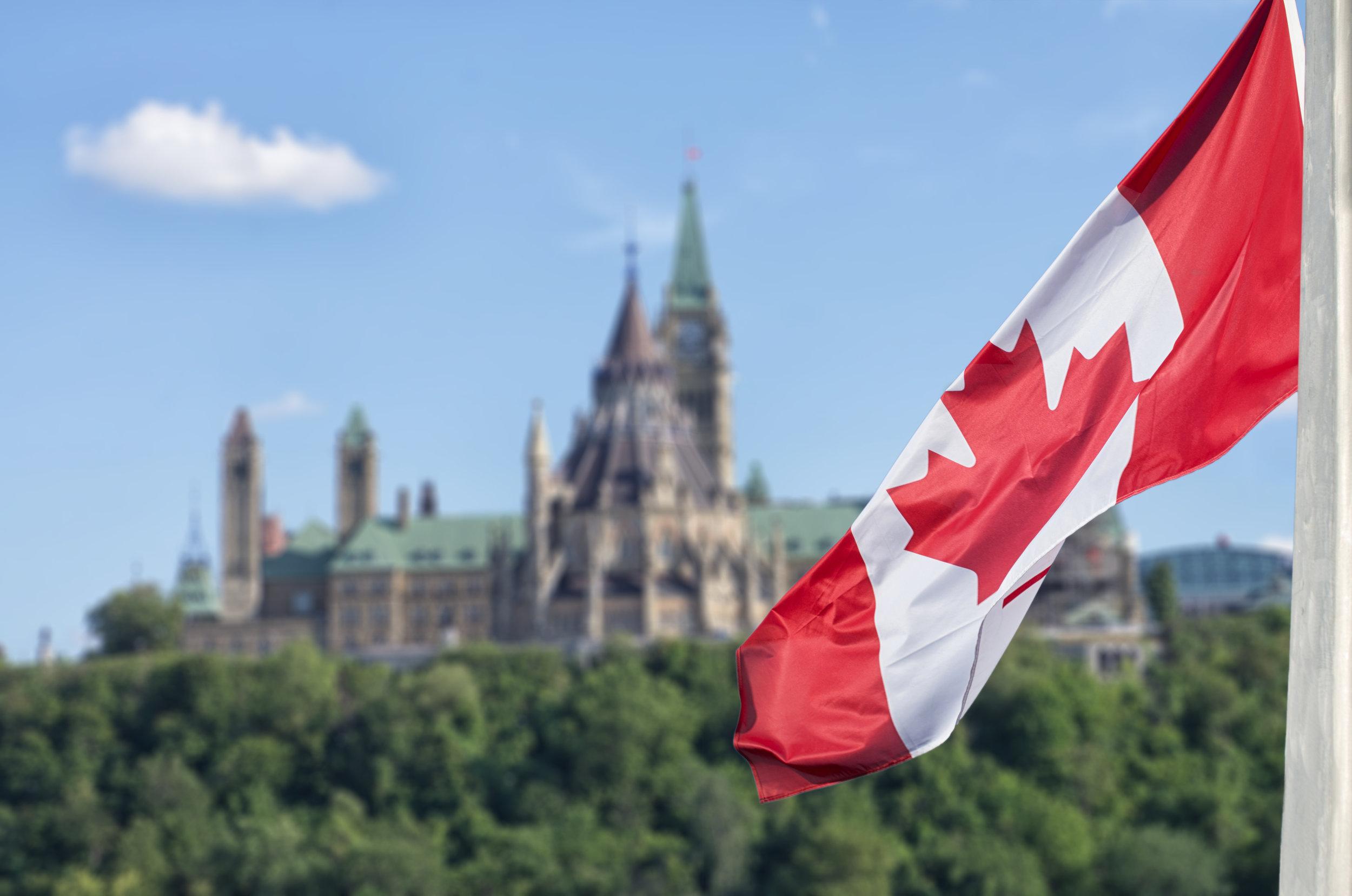 canada flag and parliament.jpeg