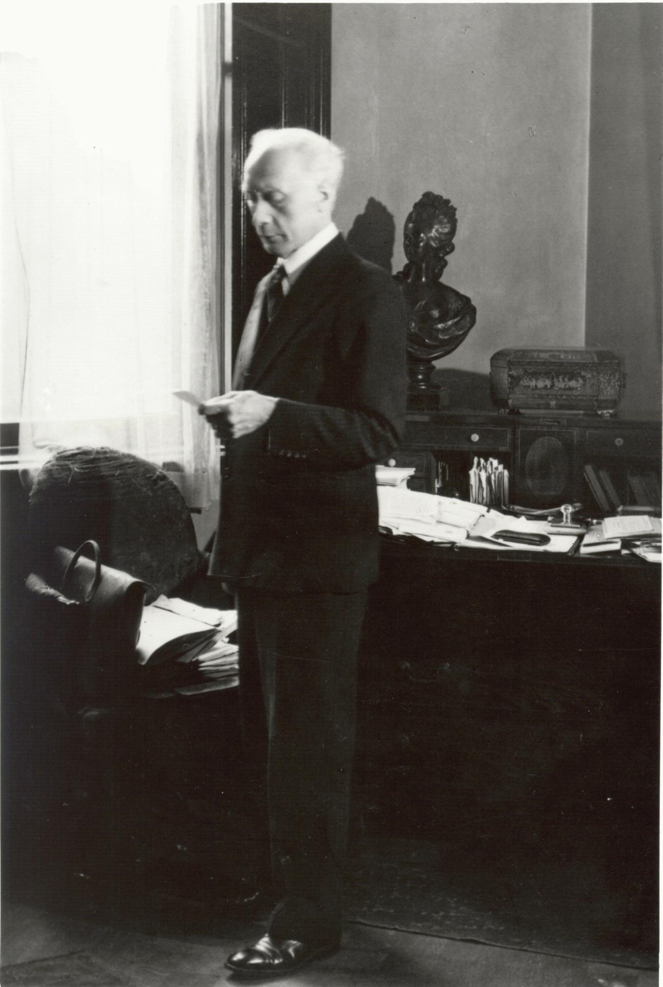 FM Alexander standing in his room