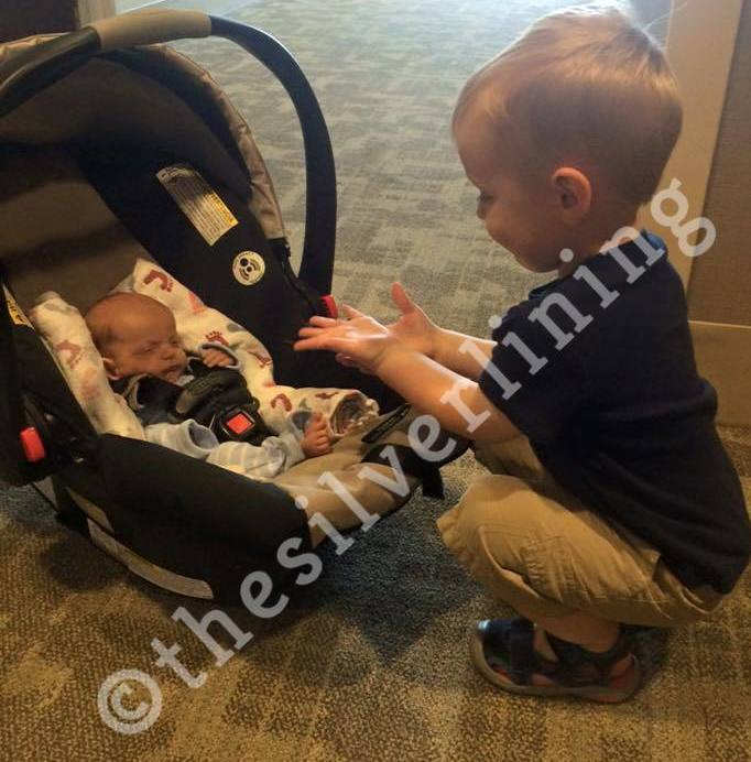 """The sweetest picture of our oldest meeting his baby sister for the first time… five weeks after she was born on our """"Going Home"""" day!"""