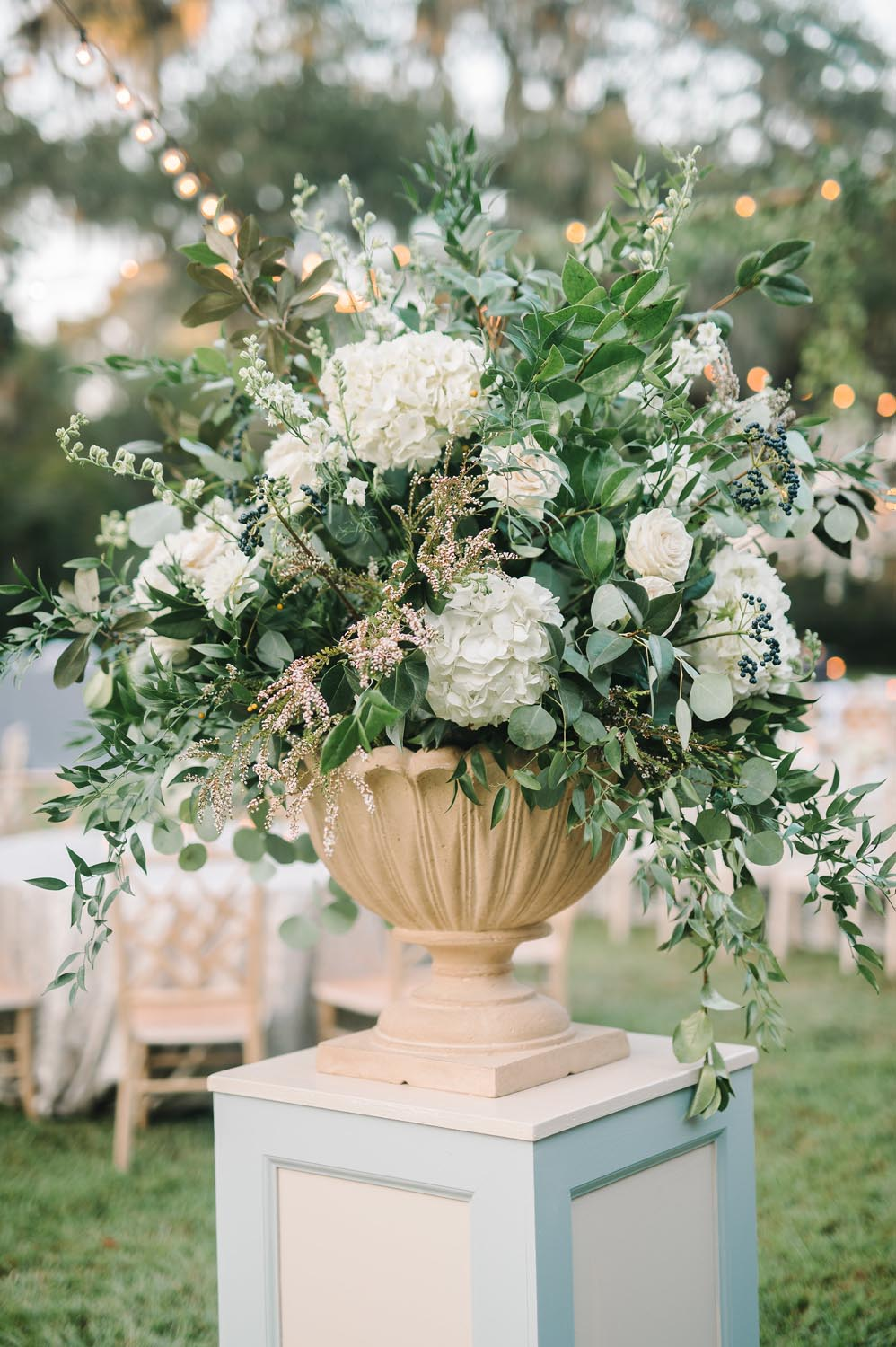 Wedding planning and design by A Charleston Bride. They were influenced by the couple's ties to both New Orleans and Texas and used touches of both states to create this outdoor, glam wedding.