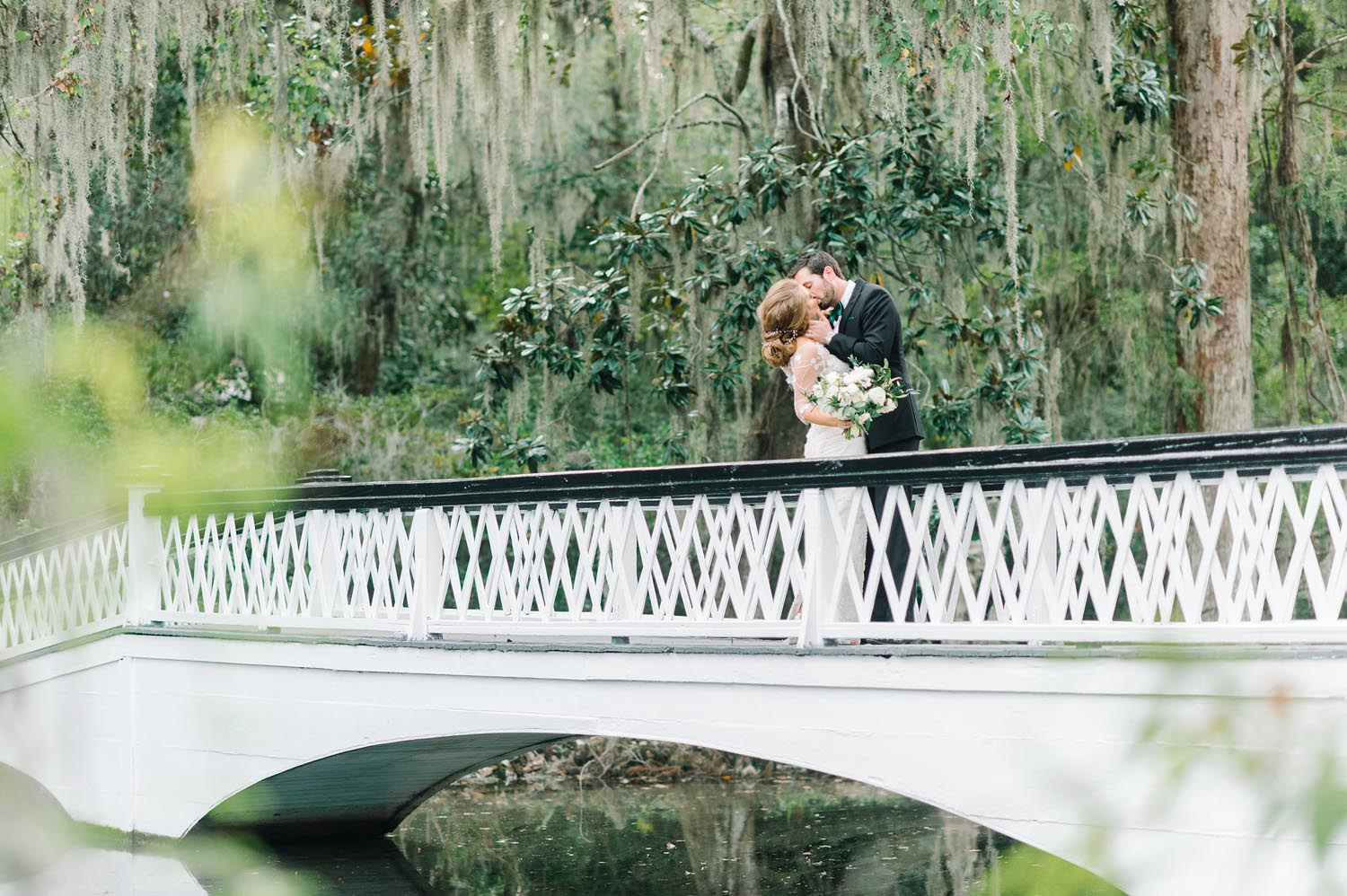 The garden's natural beauty overflowed with greenery and oaks dripping in Spanish moss. Wedding planning and design by A Charleston Bride