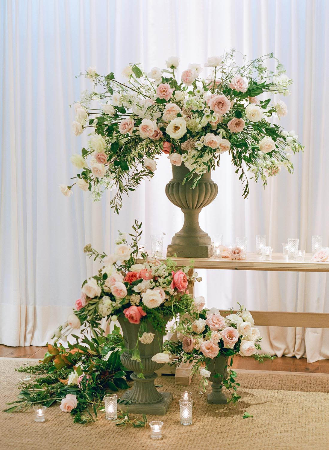Lush foliage and floral arrangements to frame out the live band. Wedding planning and design by A Charleston Bride.