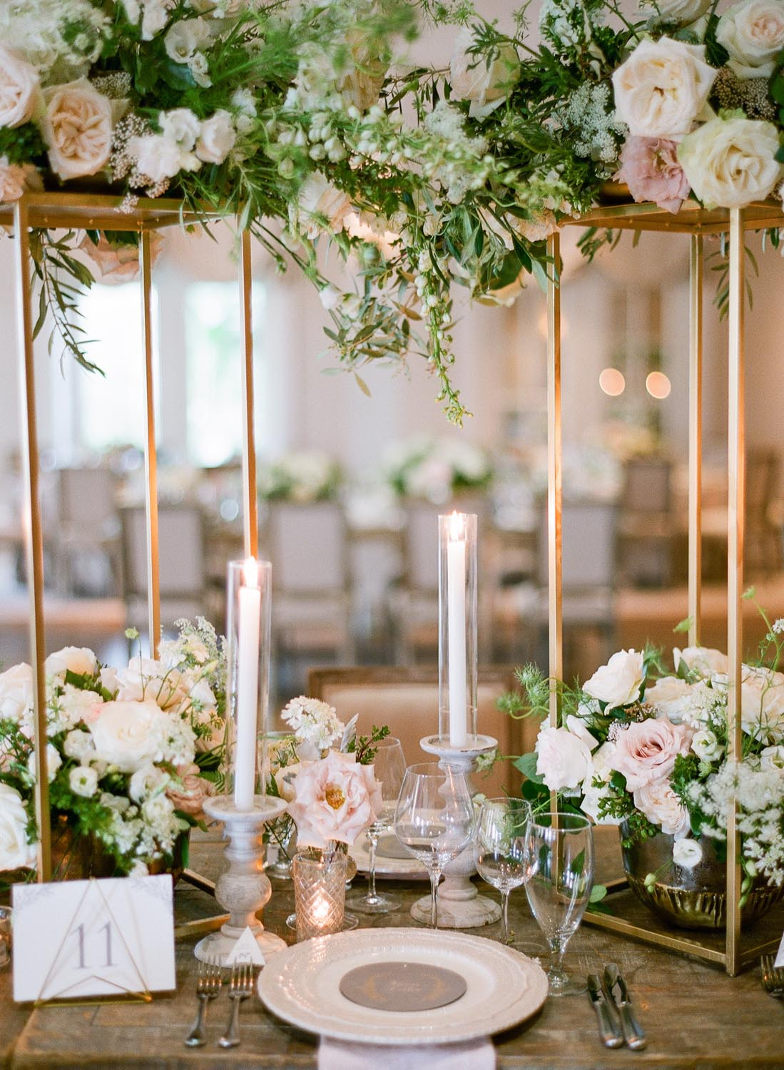 Taper candles and low rose floral arrangements. Wedding planning and design by A Charleston Bride.
