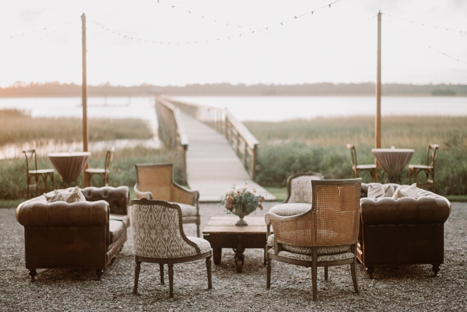 Leather and bamboo wedding lounge area. Wedding planning and design by A Charleston Bride.