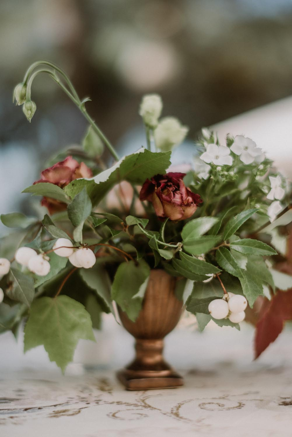 Grey and plum wedding design with roses and trailing greenery. Wedding planning and design by A Charleston Bride.
