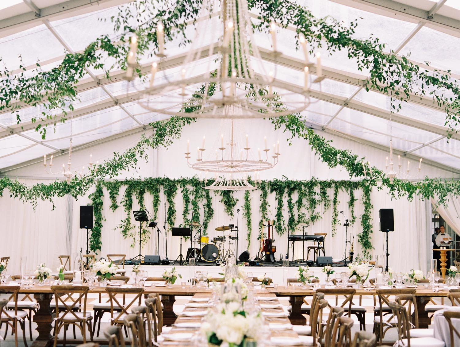 From the clear top tent dripping in greenery to the clean lines of fabric hugging the perimeter of the space, this outdoor wedding was the epitome of southern sophistication. A Charleston Bride.