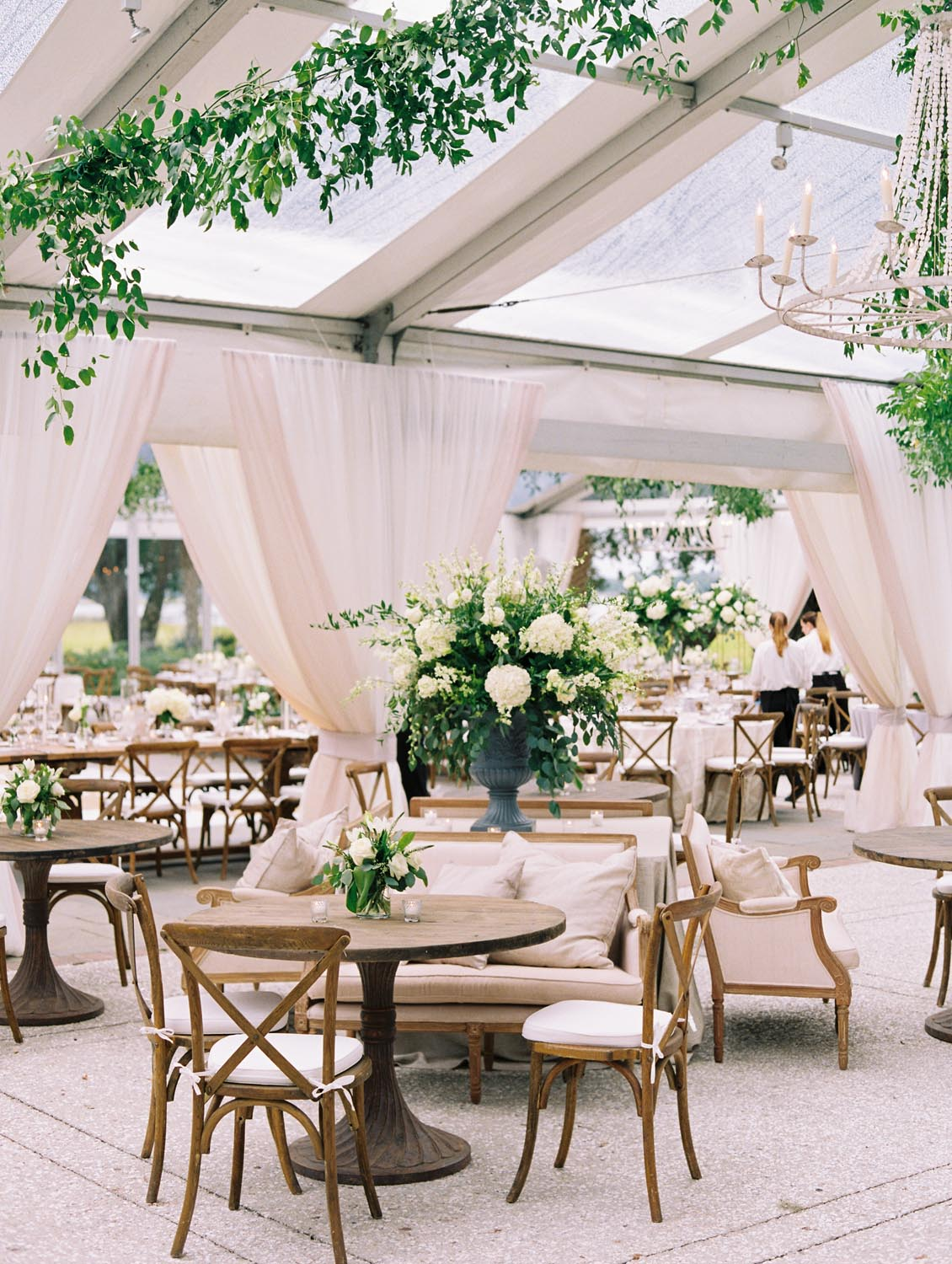 Elegant, gracious wedding with high centerpieces and long farm house style tables. Wedding planning and design by A Charleston Bride.