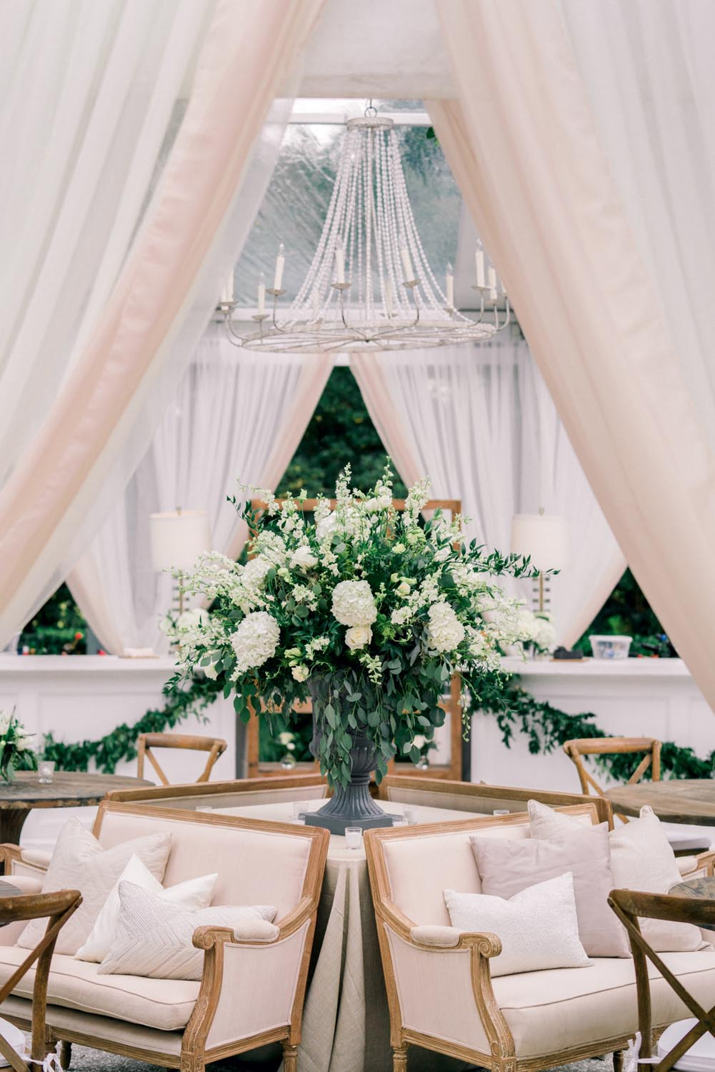 Lounge seating area with tall white centerpiece. Wedding planning and design by A Charleston Bride.