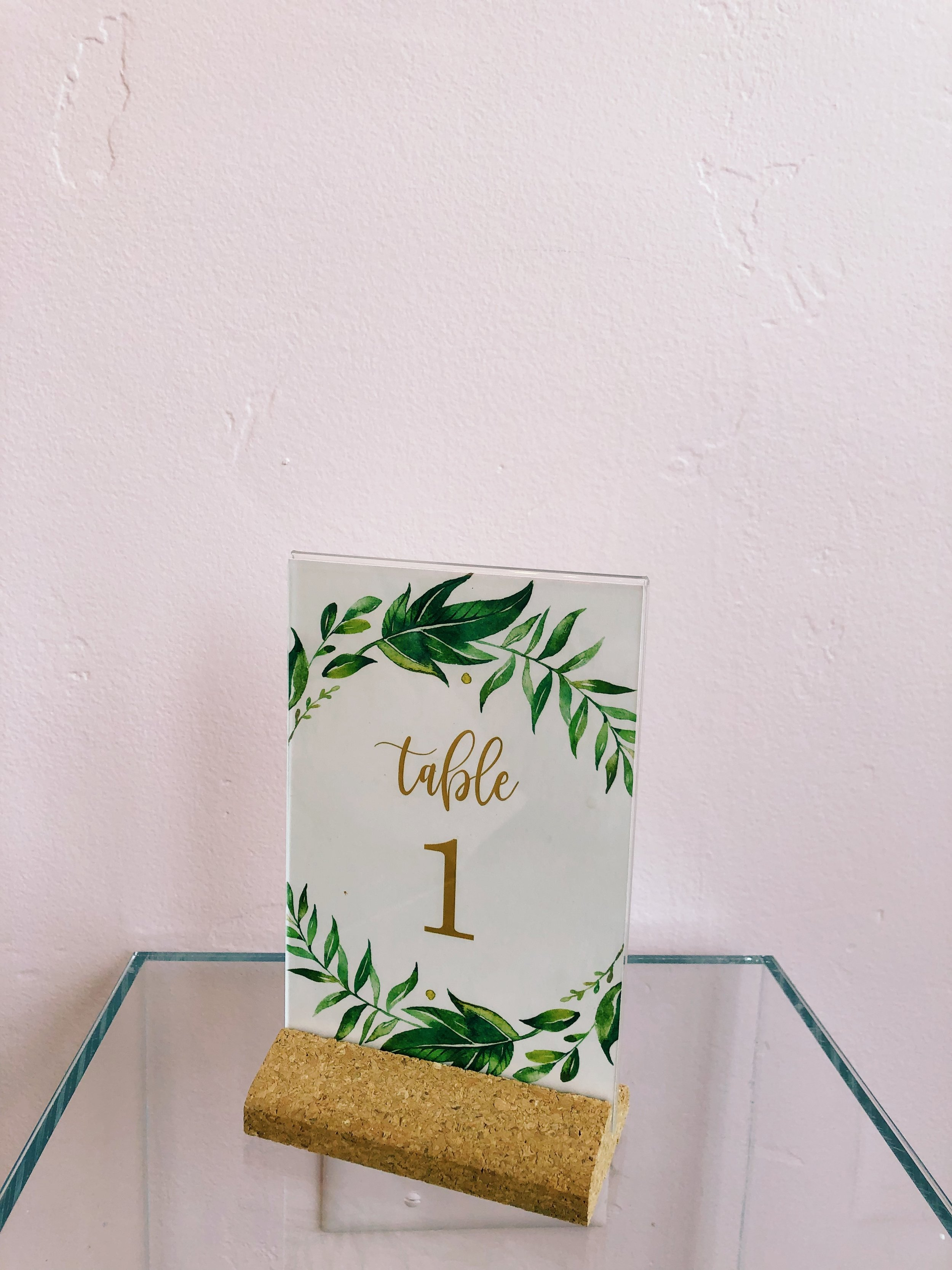 "Cork Customizable Table Numbers - 1-24 available in the greenery motif pictured. You can also customize yourself with any 4"" x 6"" card stock."