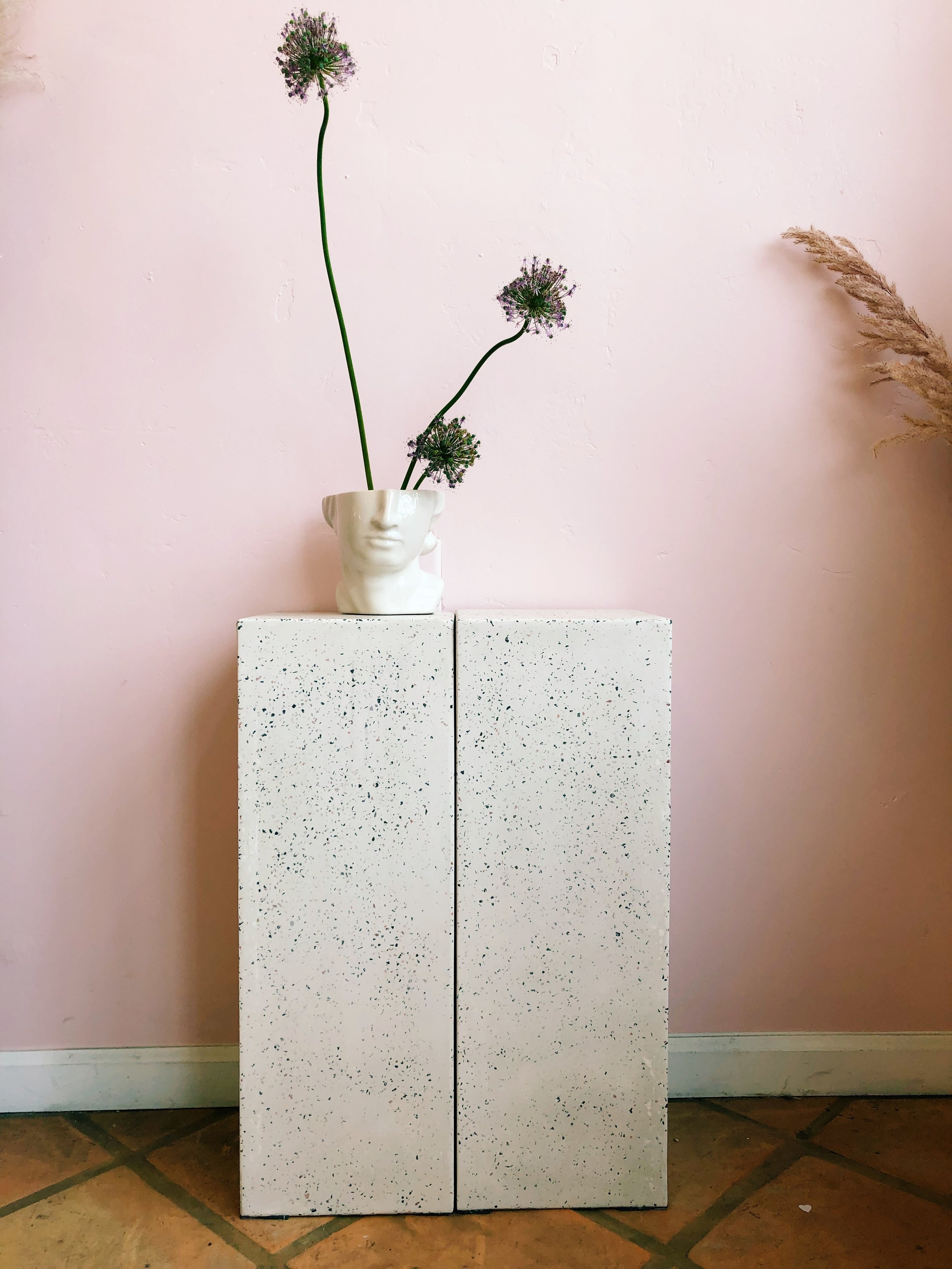 "Terrazzo Stand - White speckled with pinks, greys, and blues. Perfect for ceremony stands. Two available. 10"" x 10"" x 27.5""."