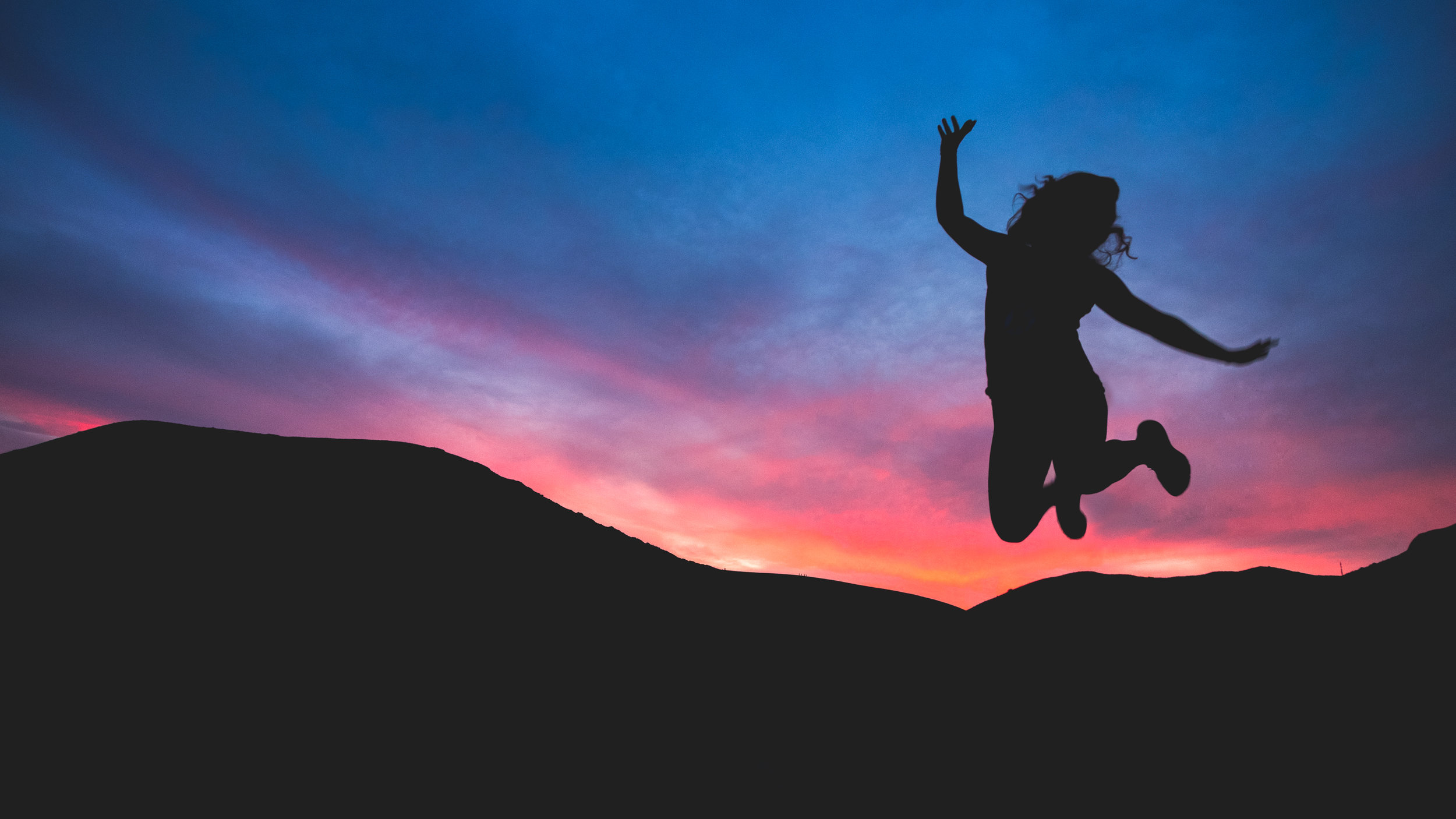 Woman jumping for joy. depression therapy charlotte, nc