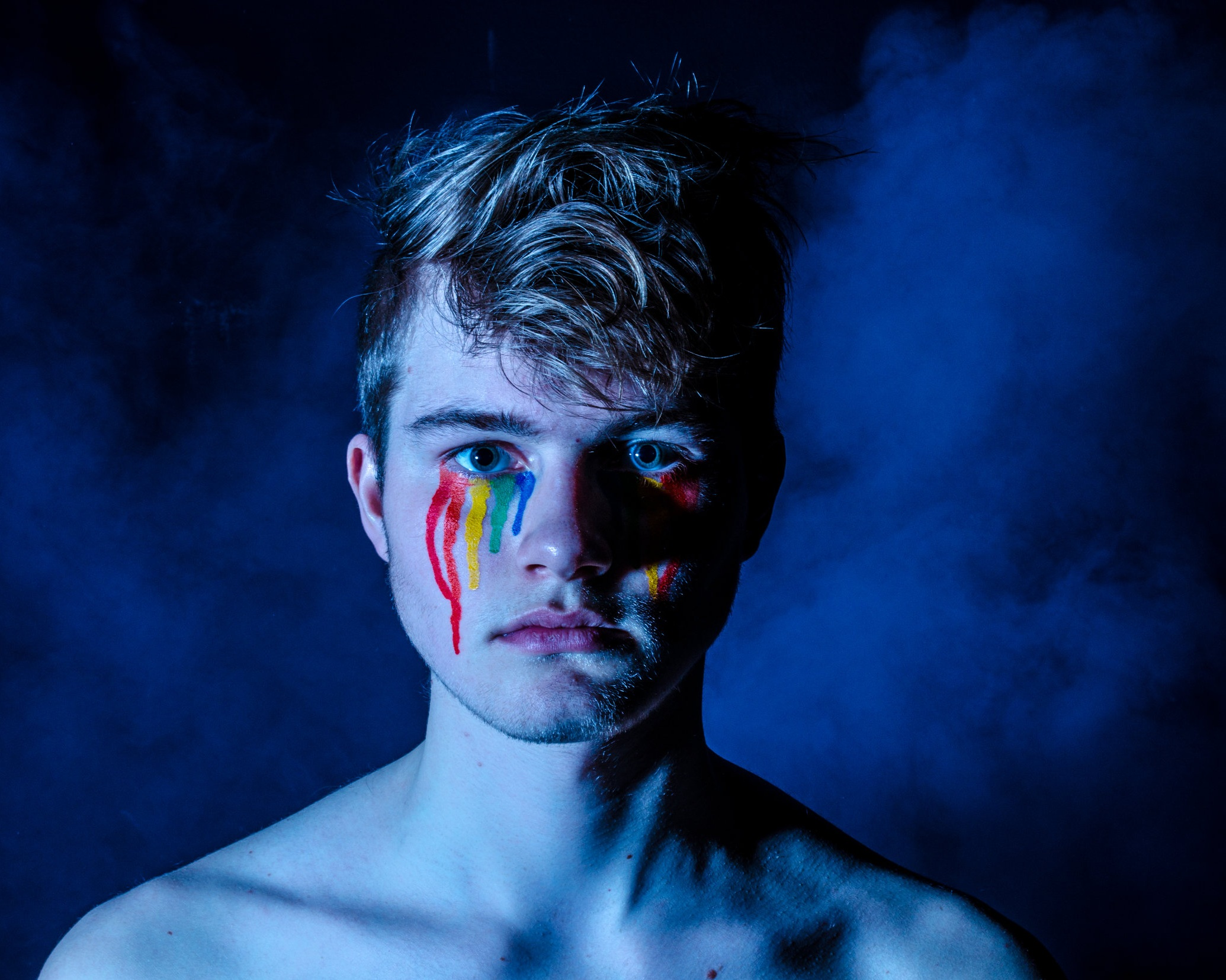 Boy with rainbow paint for tears.  lgbt counseling in charlotte, nc