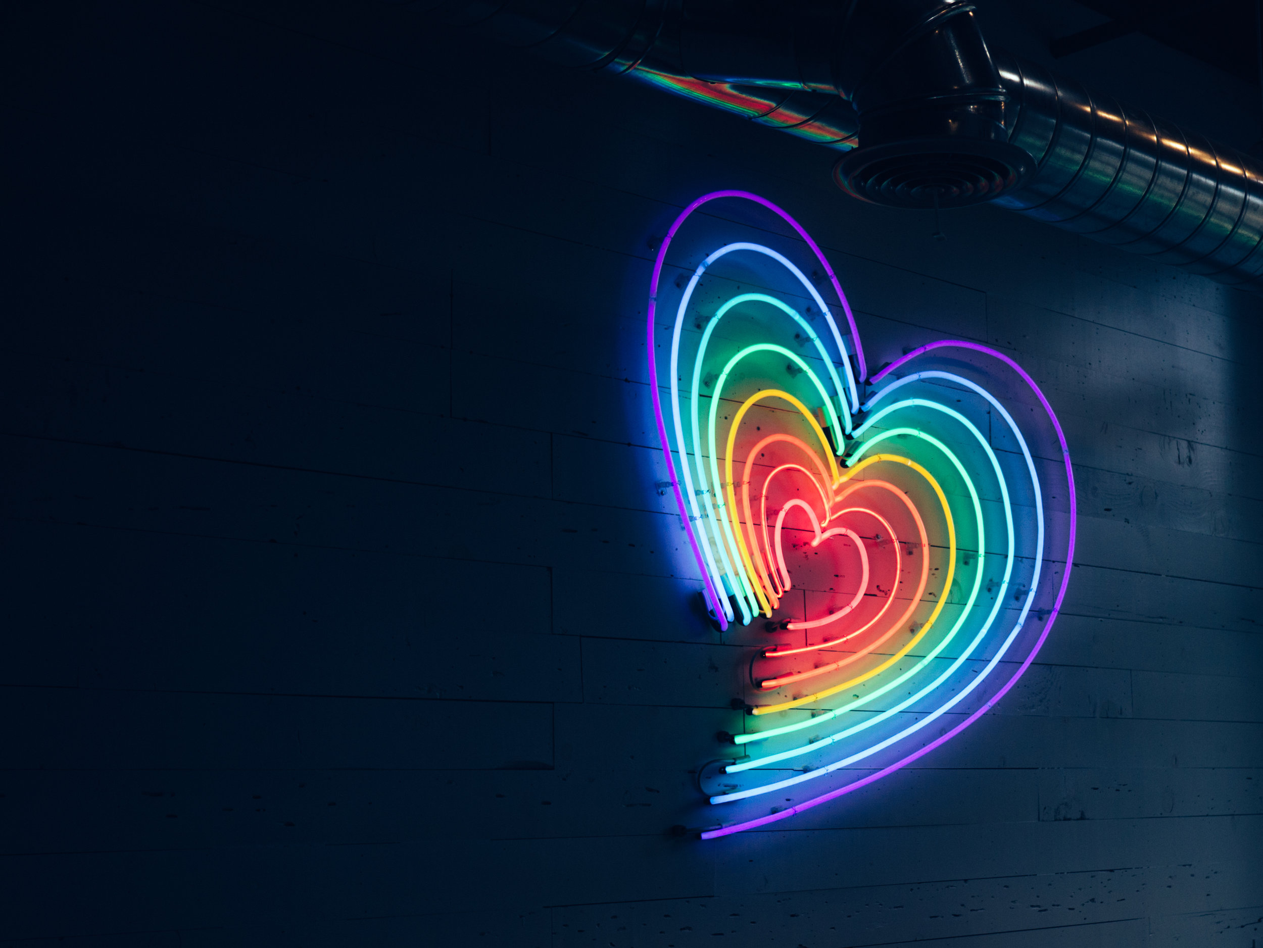 colorful lit up rainbow heart. lgbt charlotte, nc