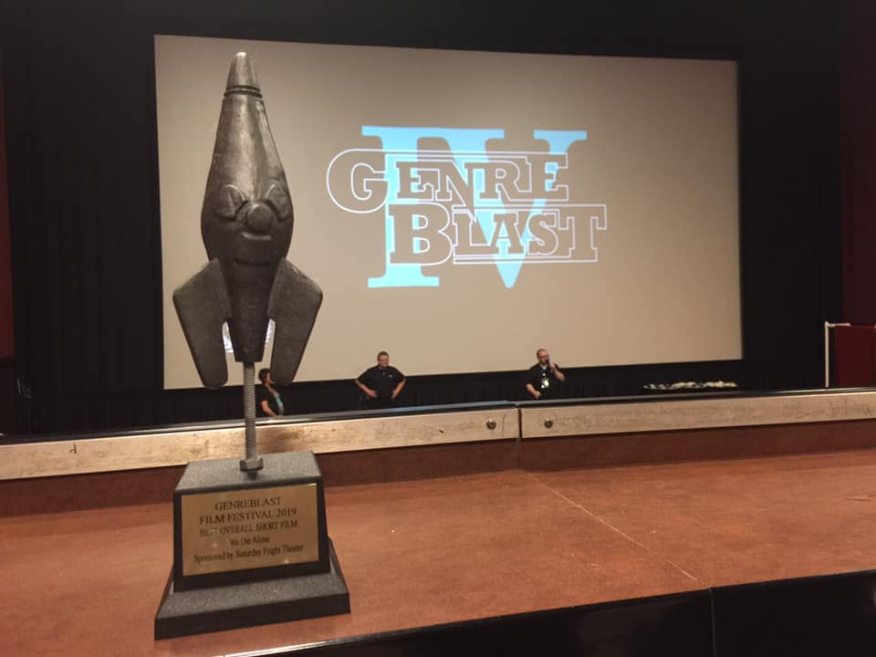 """Pictured: trophy for """"We Die Alone"""" directed by Marc Cartwright, foreground at the GenreBlast Film Festival awards ceremony"""