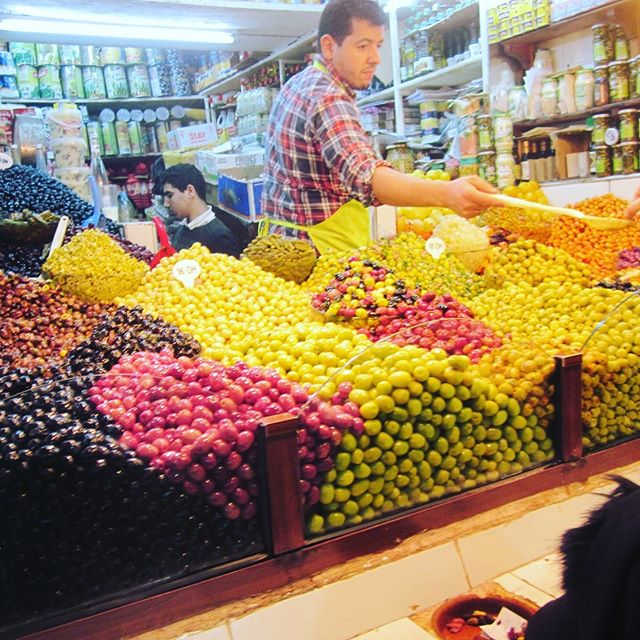 """After 40 years working in the NY Public School system, my parents, 75, are seeing the world and sending me """"high vibe"""" images of Plastic Free options! Today's image from Tangiers. Look at these gorgeous olives! No packaging required, just bring your own jar!  In Asheville, we buy our olives in bulk too, plastic-free, weighing our reusable jar first."""