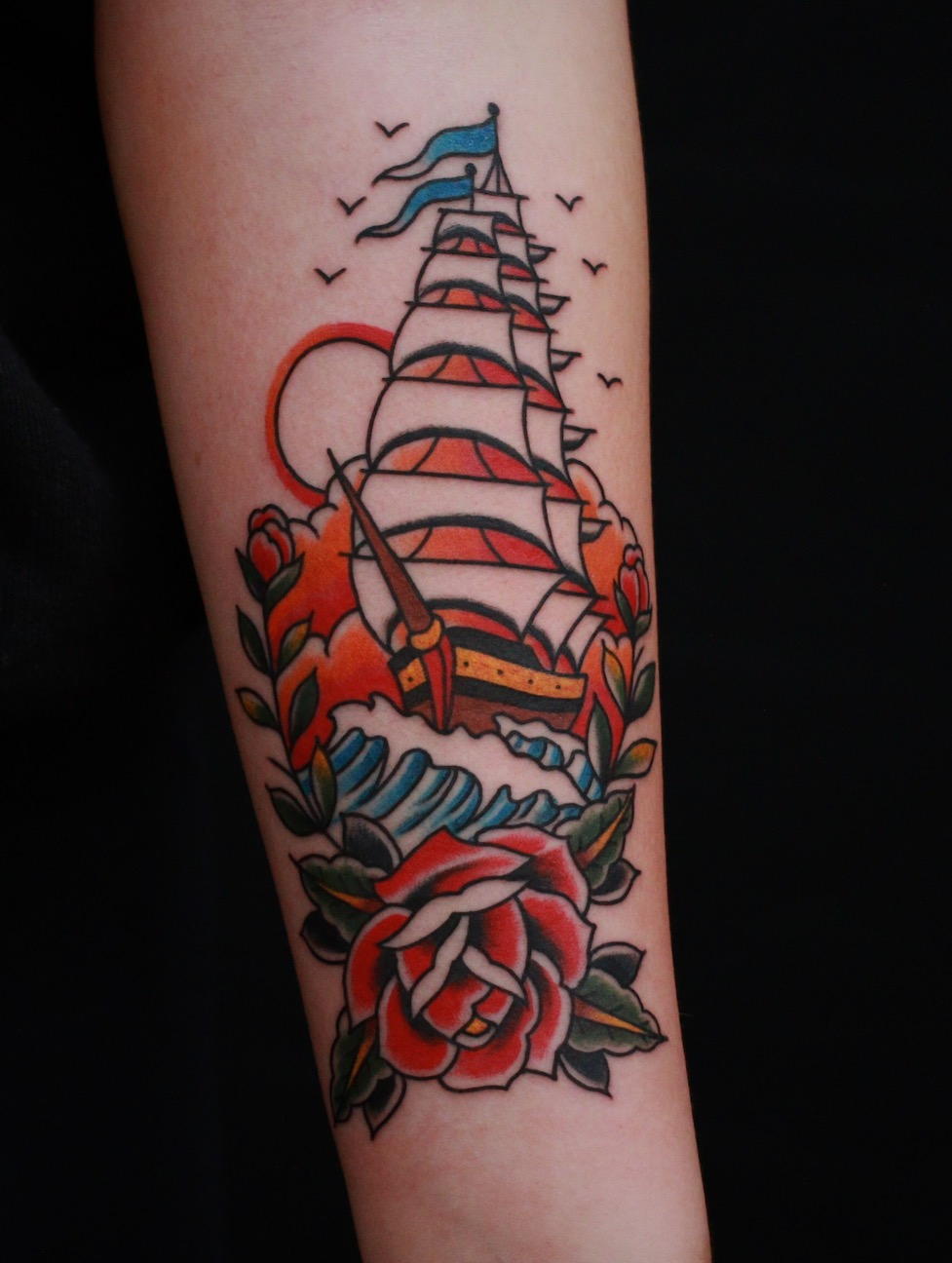 Traditional ship rose tattoo