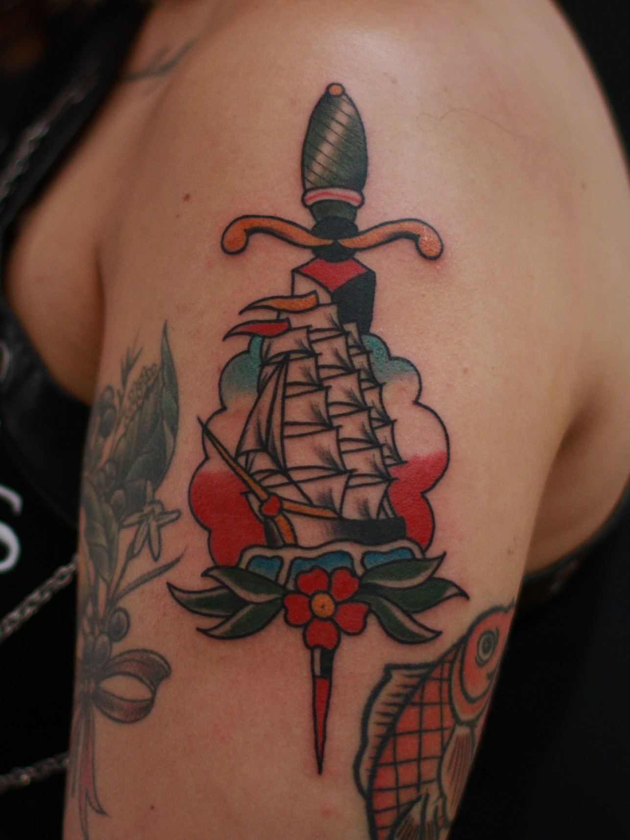 Traditional ship dagger tattoo