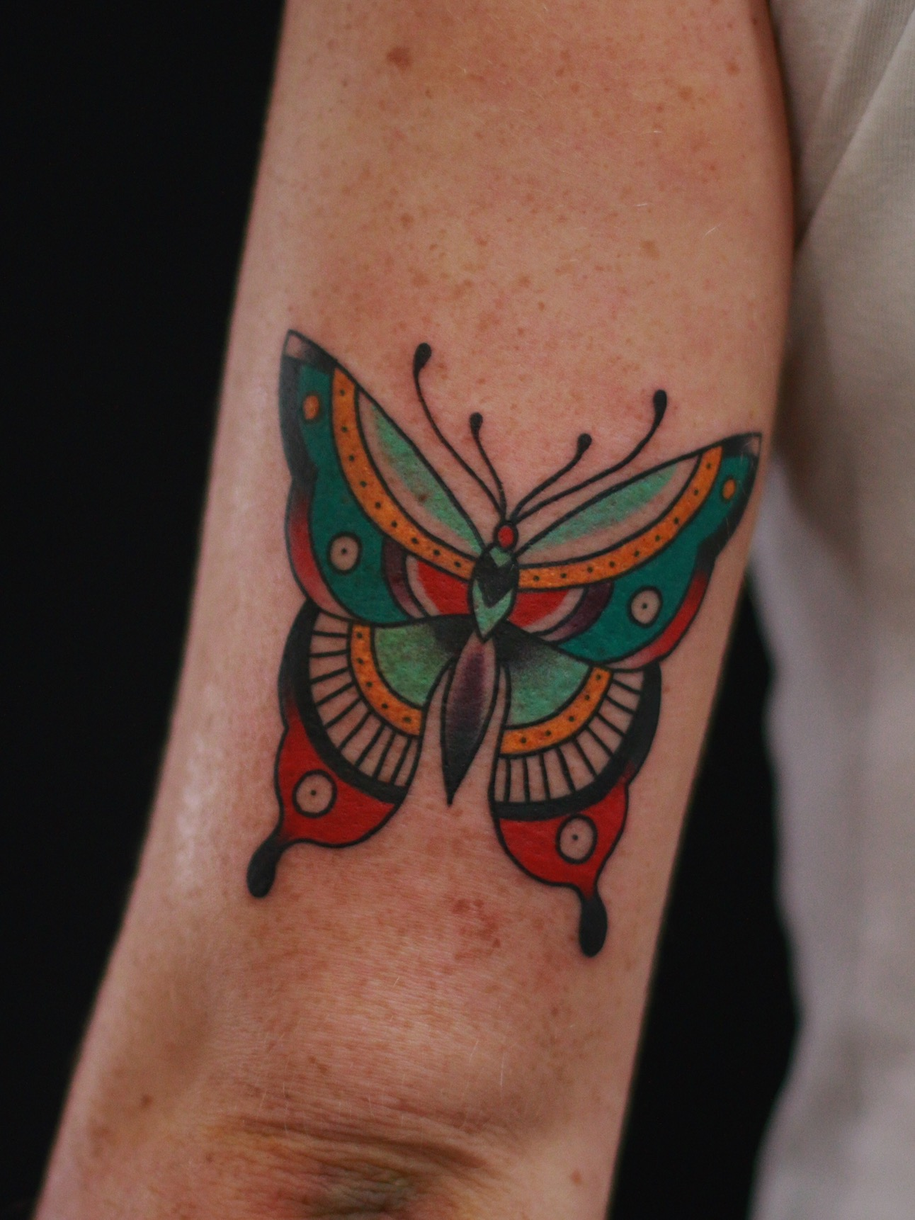 Colourful butterfly tattoo