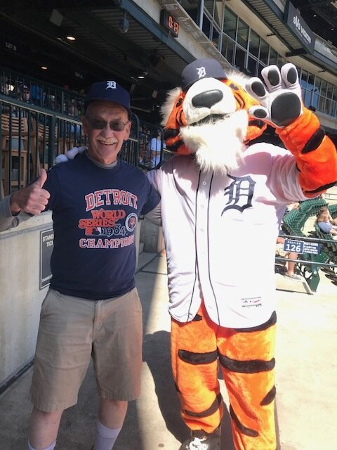 Paws, the Tiger mascot with some dude.