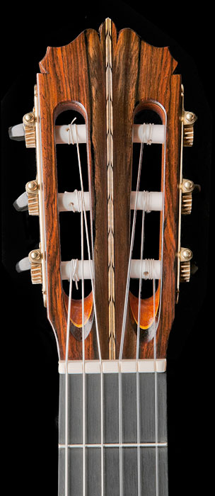 Headstock detail showing flame maple/ebony herringbone centerstrip