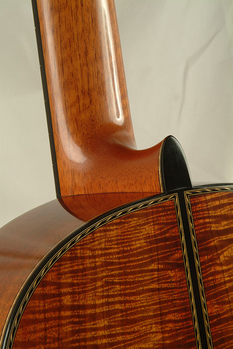 Detail showing Koa back and sides with custom marquetry