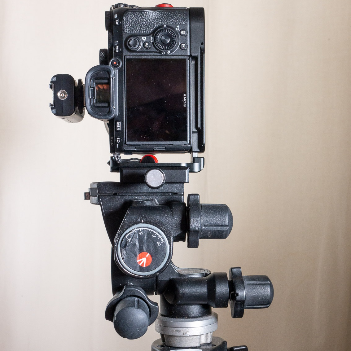When using an L-Bracket, it's much easier to get a portrait orientation with the camera and tripod head centered on the tripod.