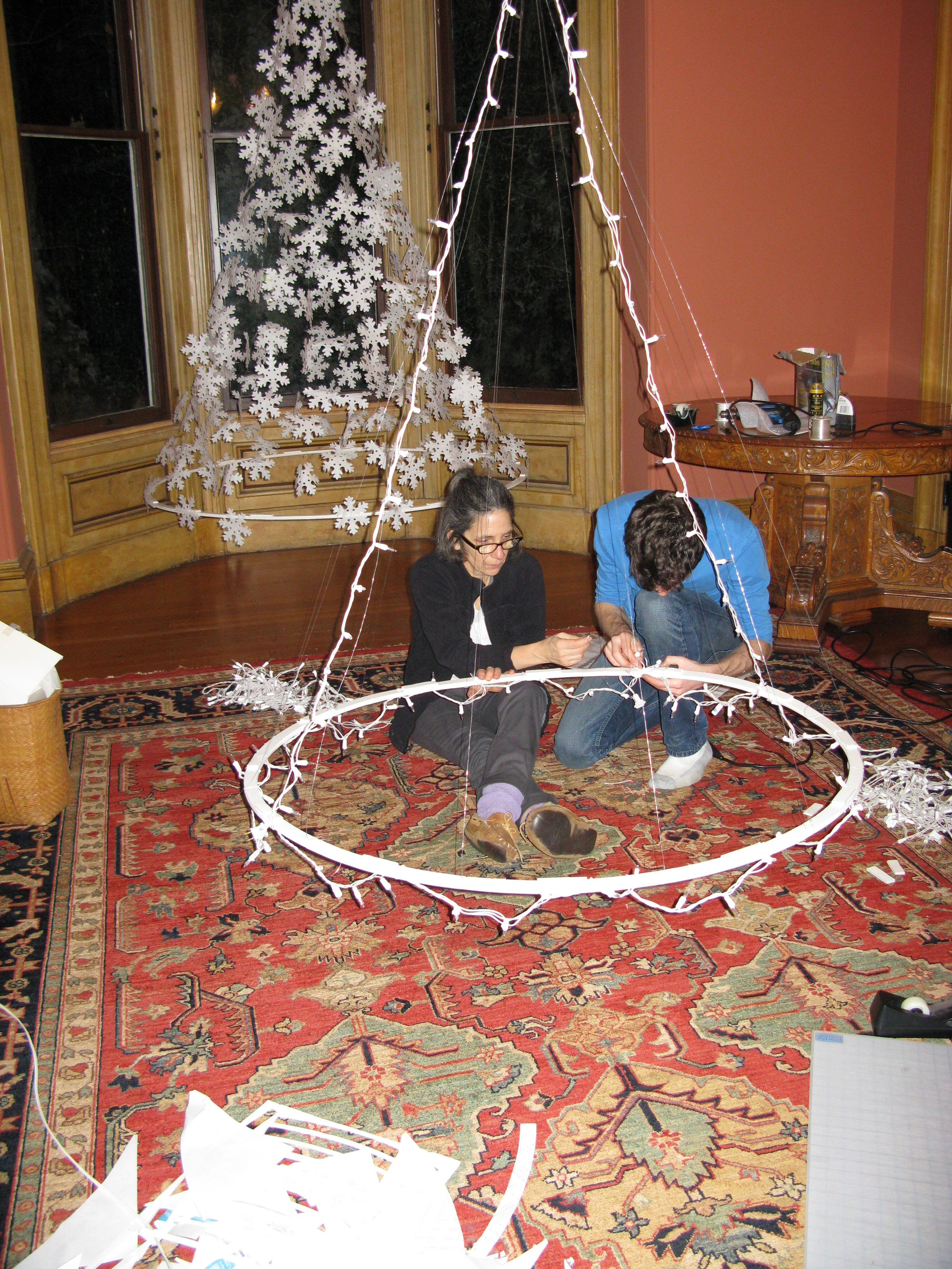 Me and my mom building the inner armature for the Christmas lights