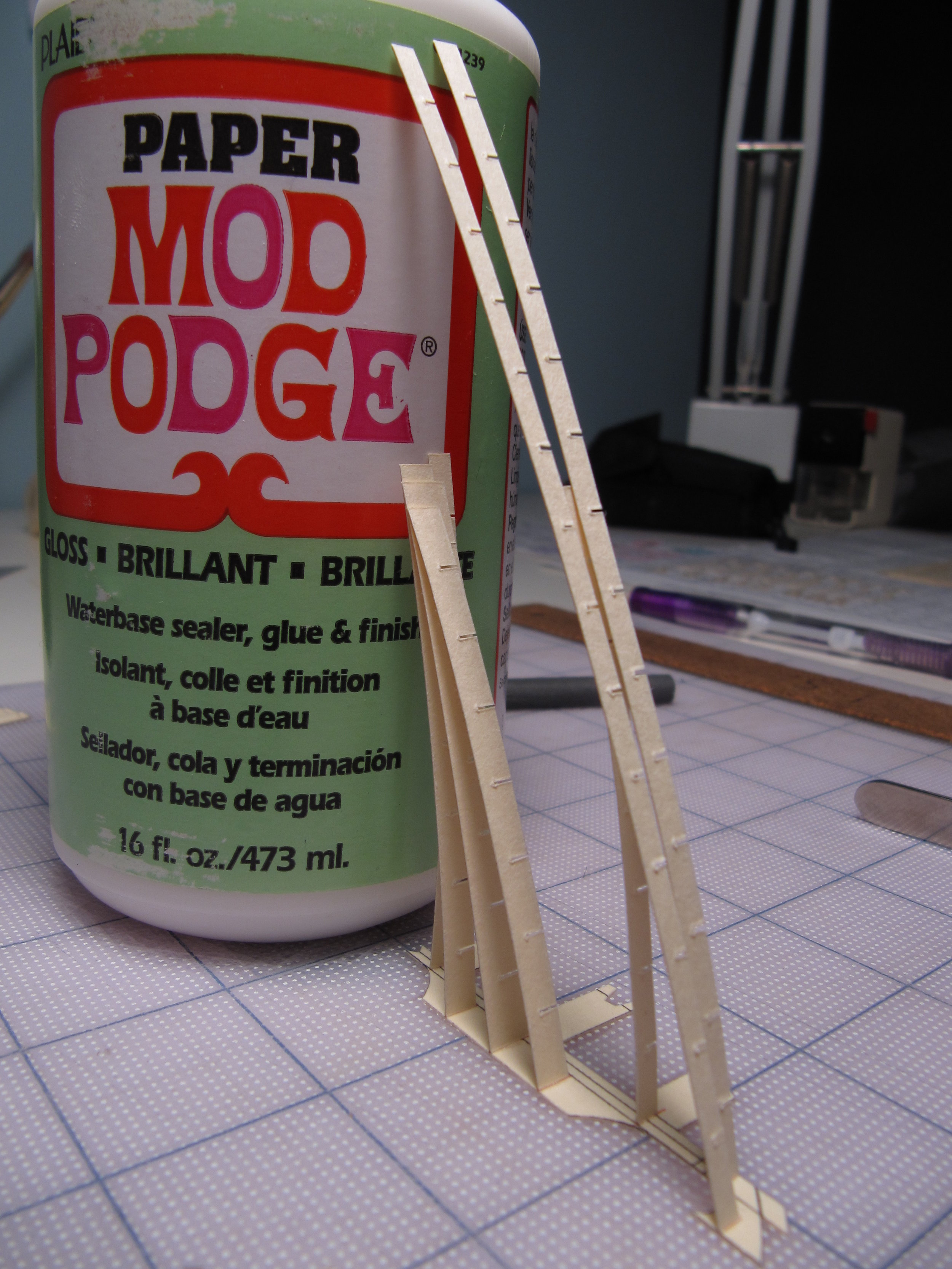 Mod Podge , which I used to create the gloss effect on the fuselage