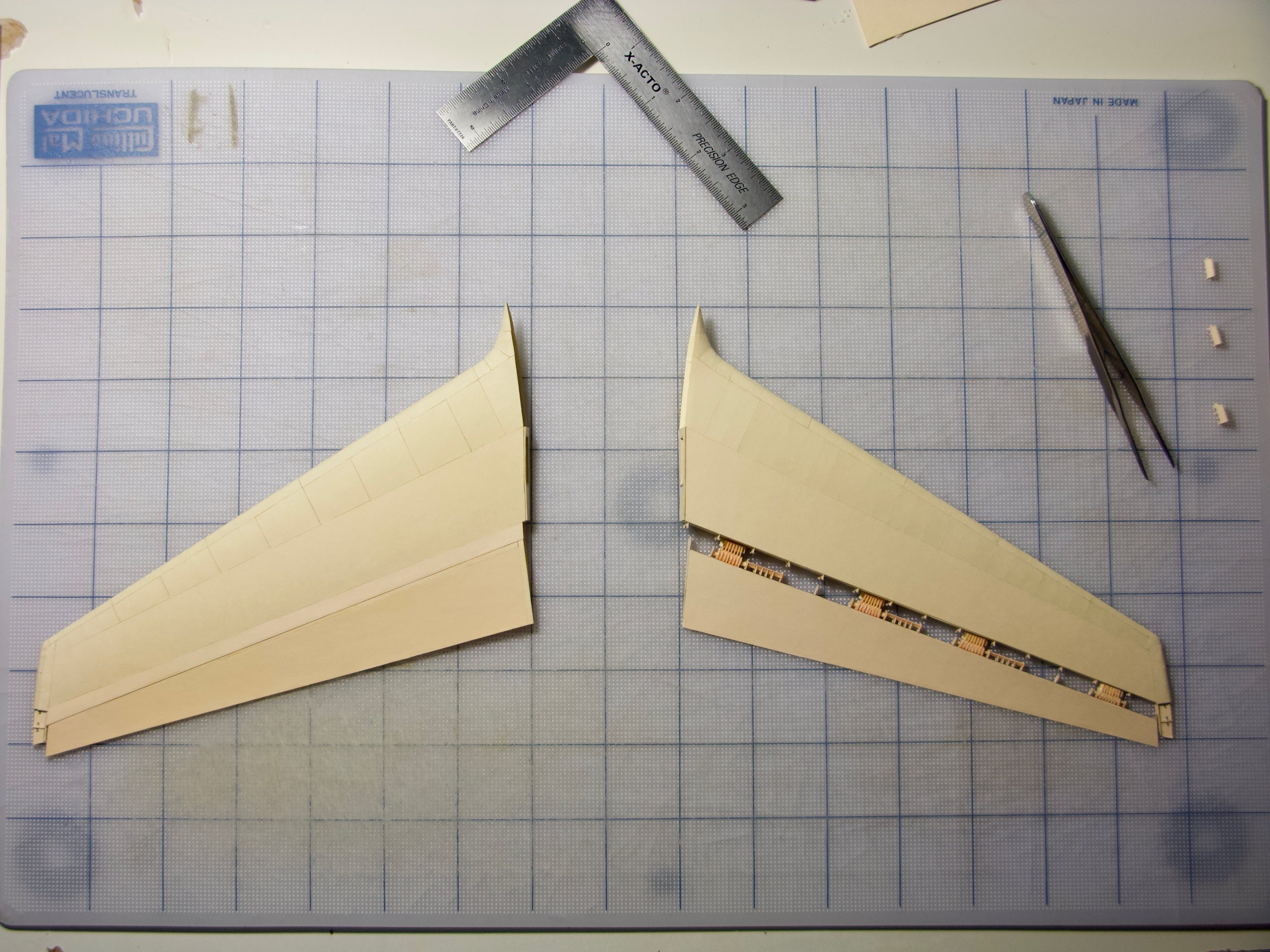 The horizontal stabilizers. On the right, the hinges can be seen
