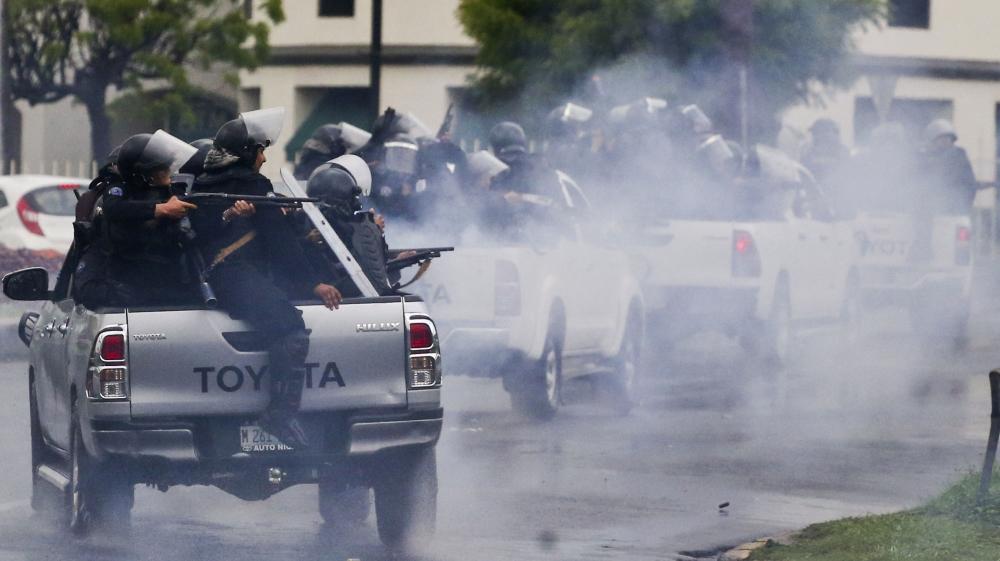 Police shoot at student protesting against Daniel Ortega. (Esteban Felix/AP.)