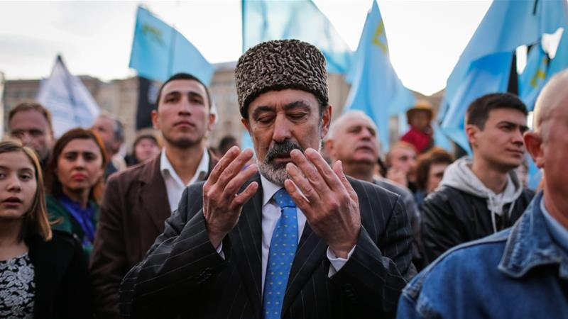 A man at a rally commemorating 70 years since the forced expulsion of Crimean Tatars by the Soviet Union. (Roman Pilipey/EPA)