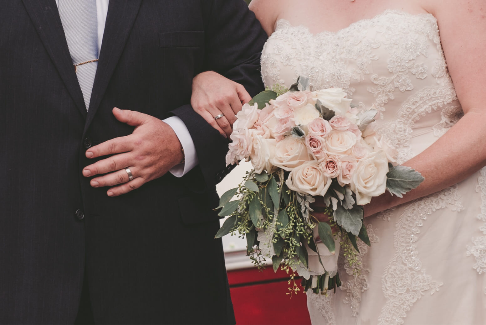 River_Rest_Weddings_Website_About_Banner-Holding_Arms.jpg