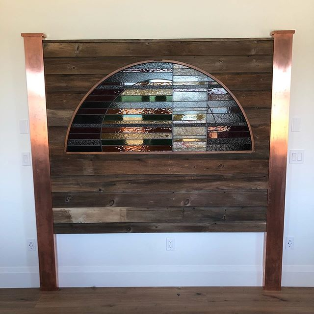 Today this king sized headboard was installed into a very special setting! It features a keepsake stained glass panel from a previous home, horizontal mid 19thc shiplap exterior siding and copper capped posts. We specialize in listening to what our customers want and then building for them. #homedecor #interiordesign #custombuild #stainedglass #shopshakespeare #stratford #antiques #canadiana