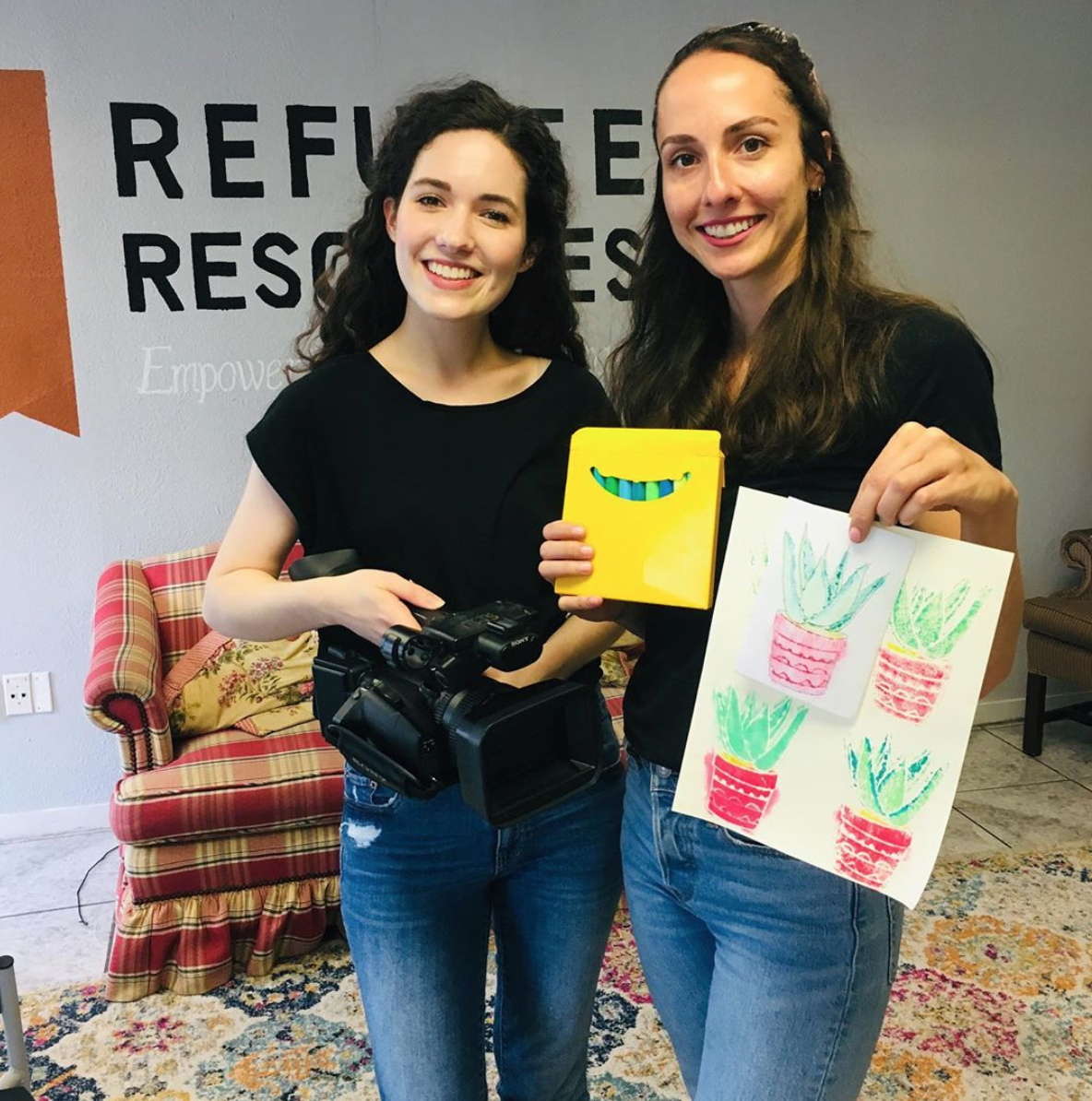 Me, left, Filming a project about literacy. - Pictured with Refugee Resources art teacher, Jordan.