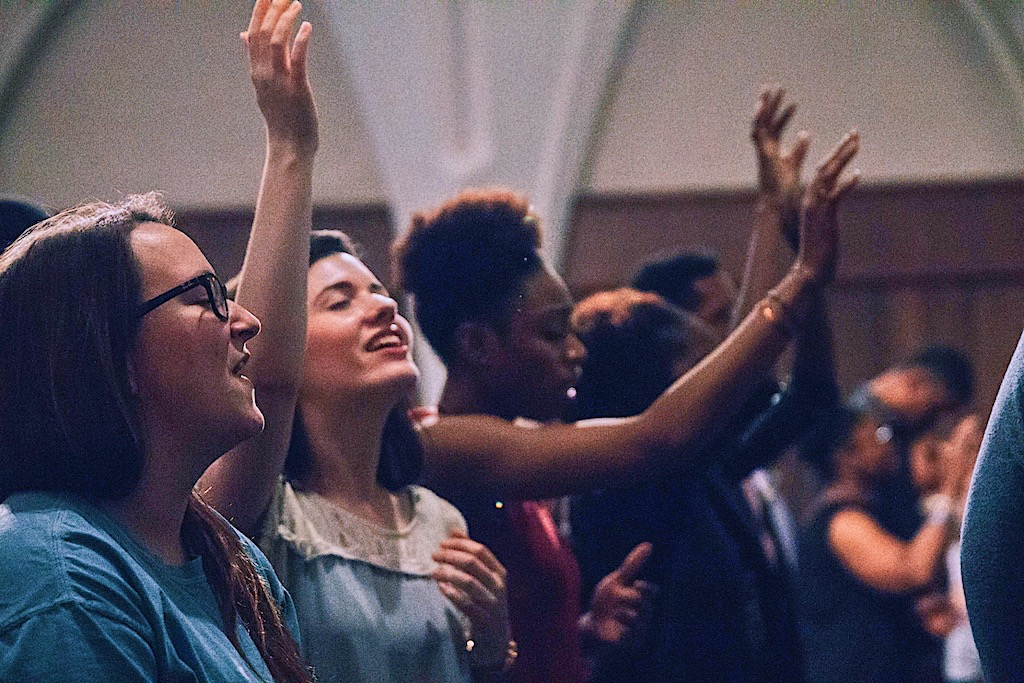 Myself, middle, and friends worshipping in Dallas, 2015.