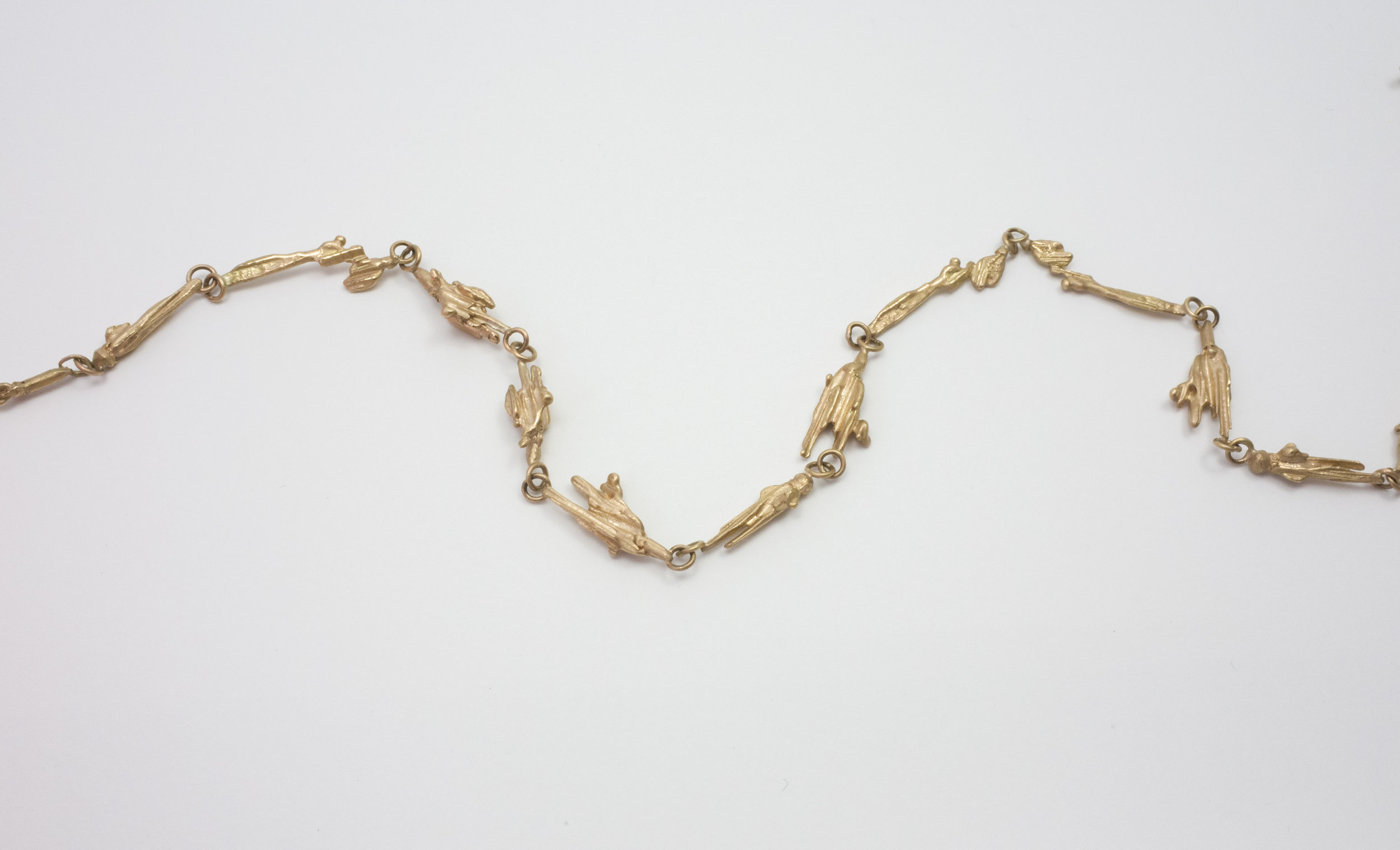 Gold Molten necklace trailing.jpg