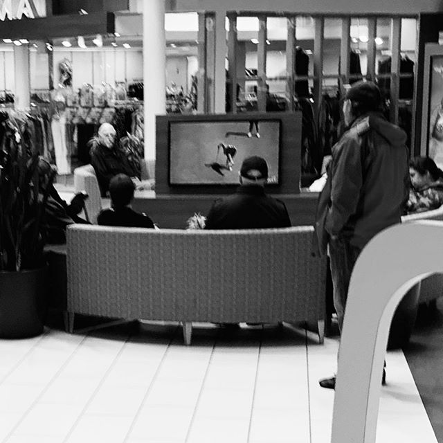 Seven guys in a mall watching golf - living the dream.