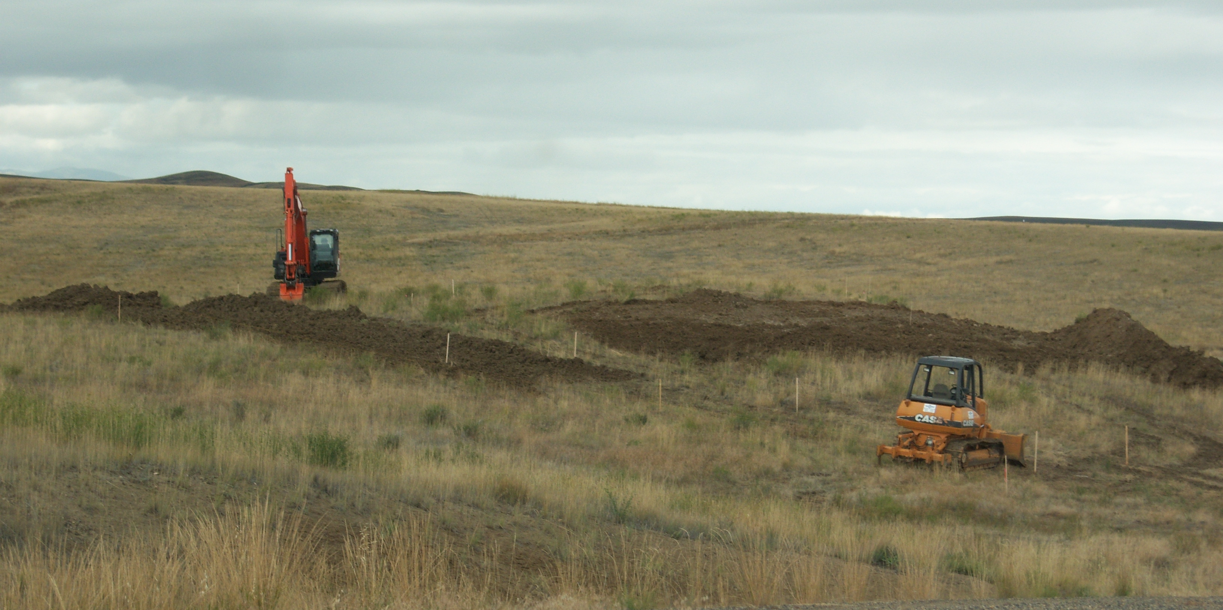 site prep  grbbng topsoil.png