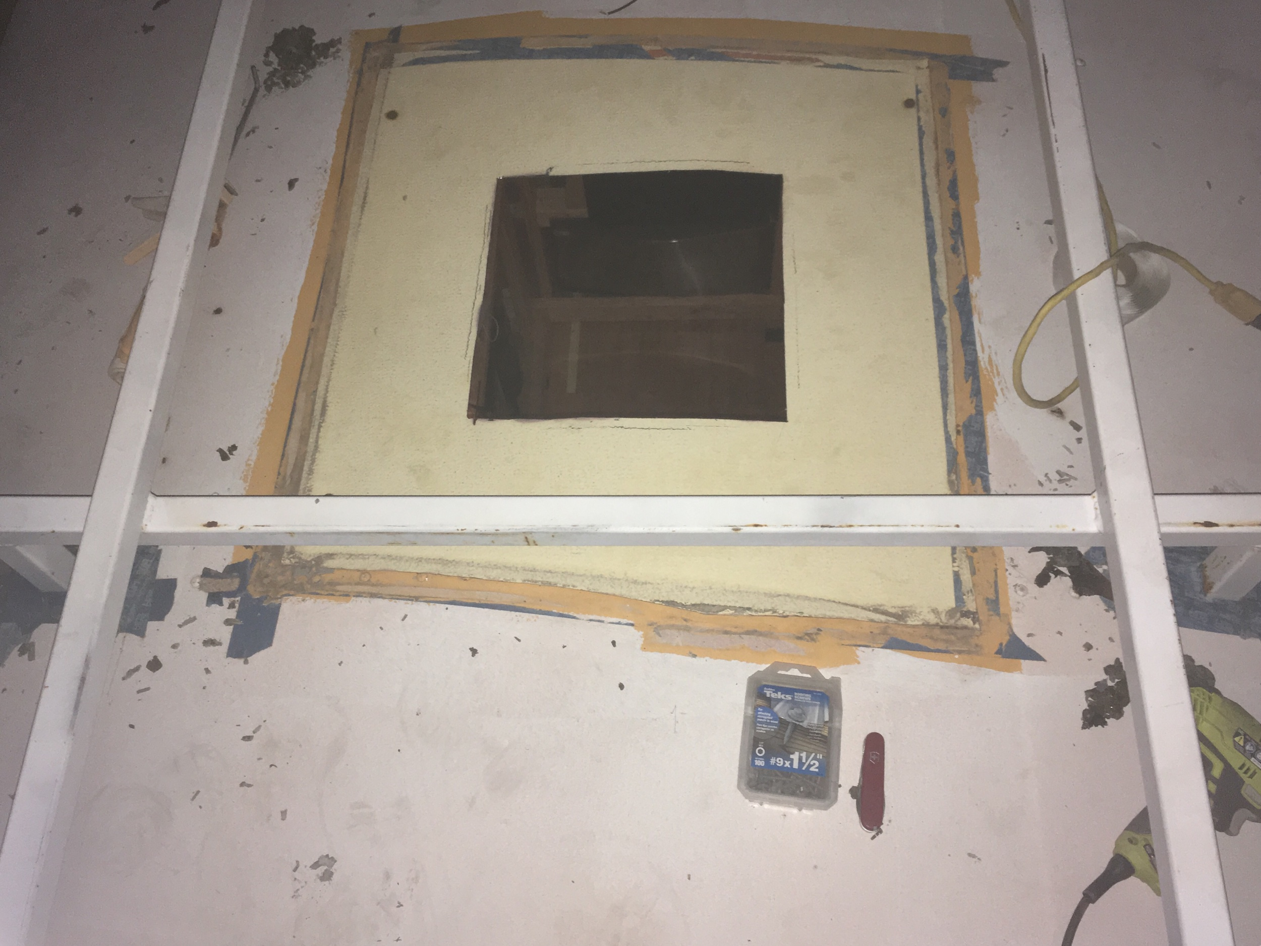 """14""""x14"""" hole cut into the ceiling. Soon to be screwed down. Butyl tape already in place below."""