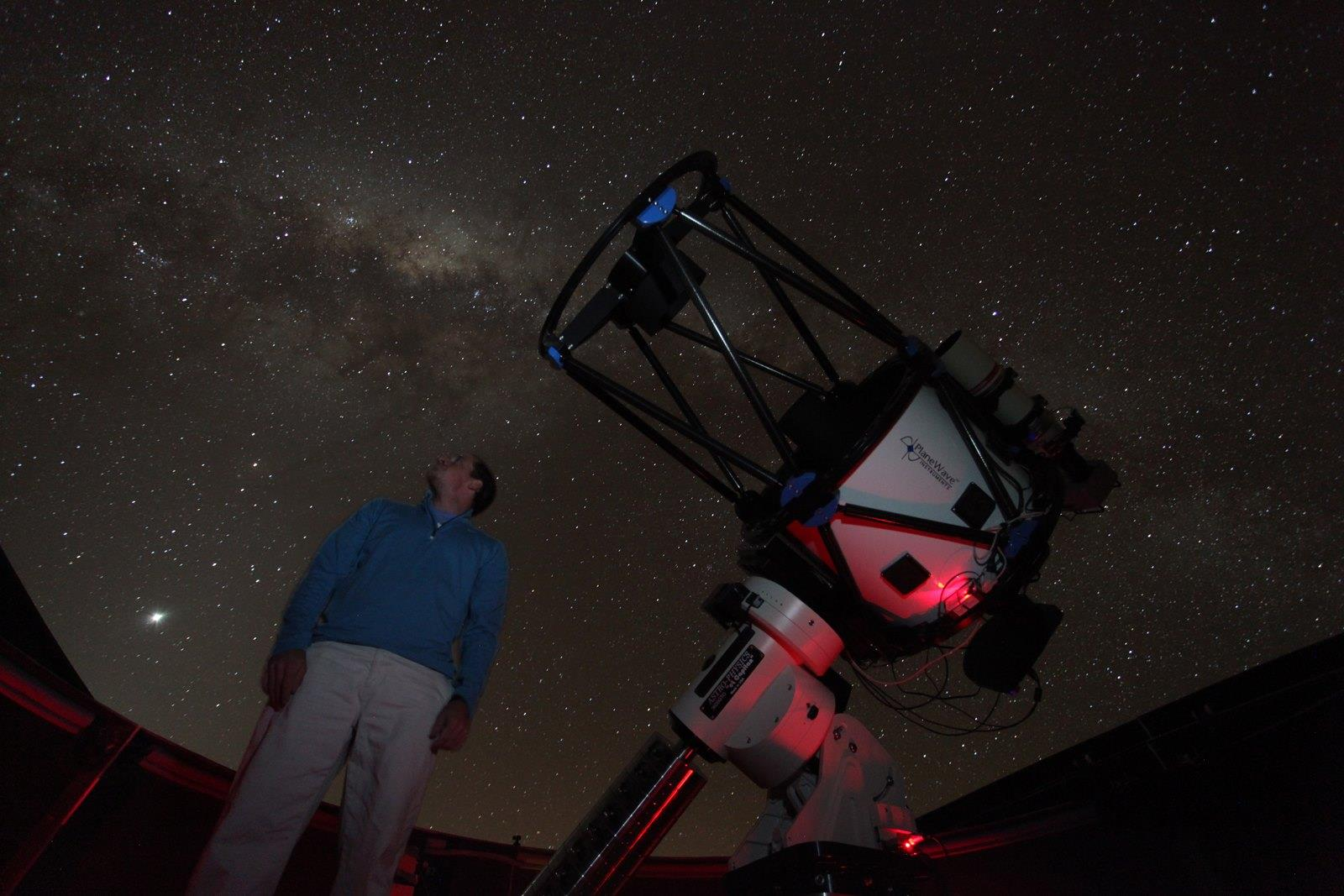 Graduate student Justin Moore and the 24-inch diameter PROMPT-8 telescope at Cerro Tololo Inter-American Observatory, Chile.
