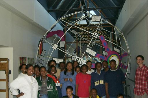 The Space Explorers in front of their completed celestial sphere and three-dimensional radio map of the northern sky