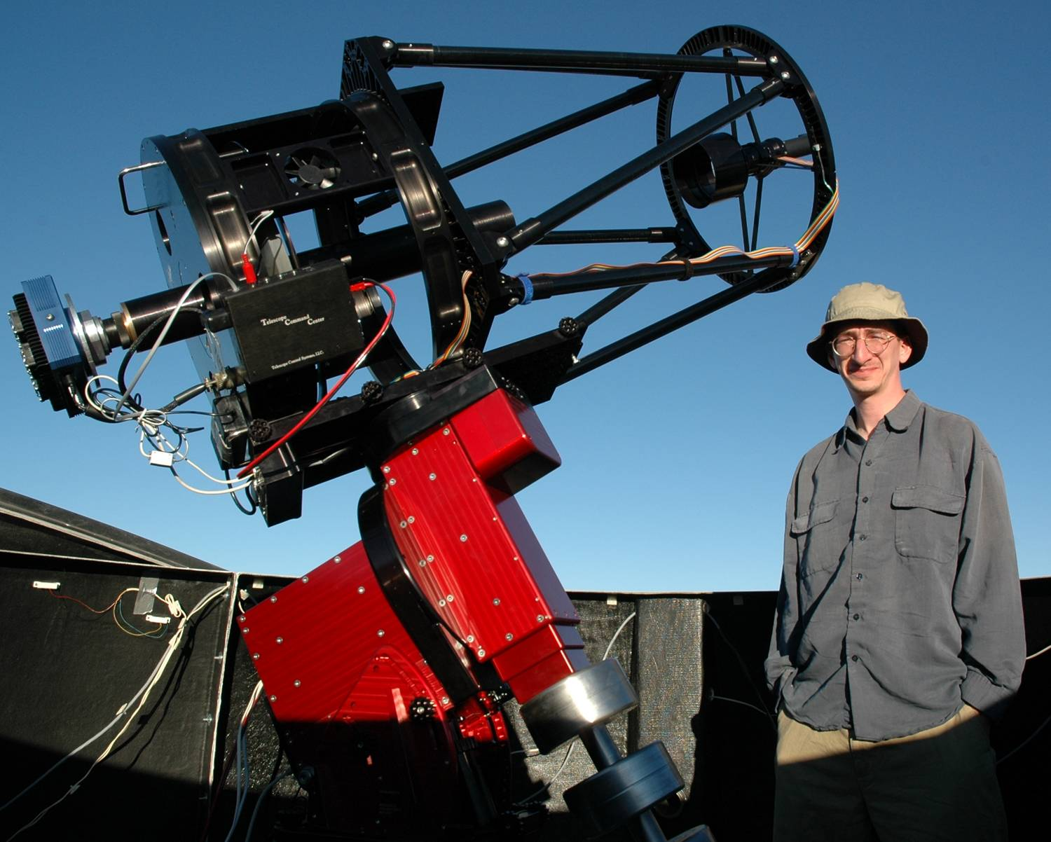 Me standing next to one of our 16-inch diameter telescopes at Cerro Tololo Inter-American Observatory in the Chilean Andes. SSRO is using an identical scope, but with an upgraded, PlaneWave Instruments Ascension 200HR mount.