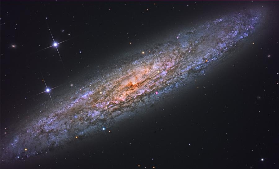 NGC 253: Dusty Island Universe